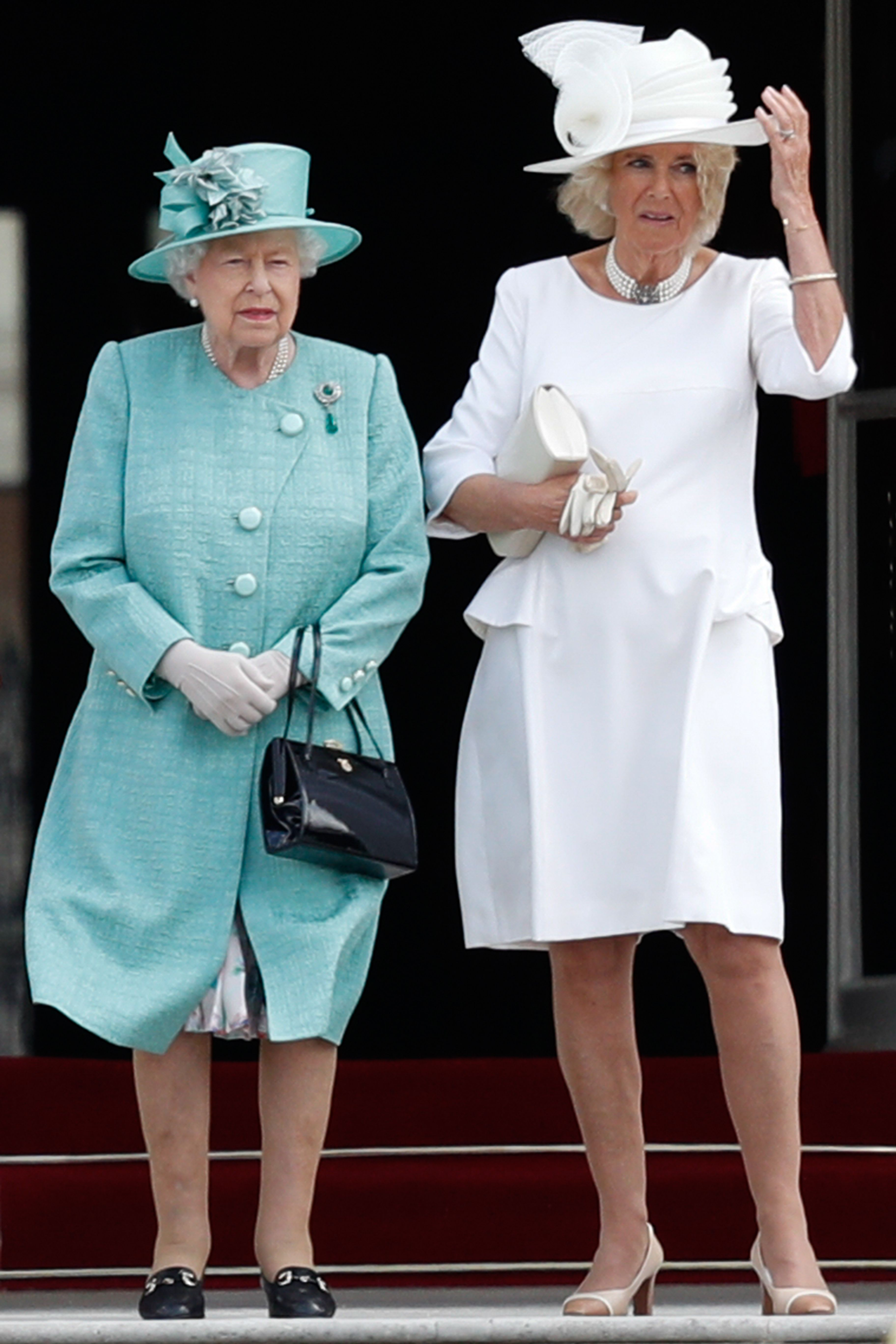 Britain's Queen Elizabeth II (L) stands with Britain's Camilla, Duchess of Cornwall (R) during a welcome ceremony at Buckingham Palace in central London on June 3, 2019, on the first day of the US president and First Lady's three-day State Visit to the UK. - Britain rolled out the red carpet for US President Donald Trump on June 3 as he arrived in Britain for a state visit already overshadowed by his outspoken remarks on Brexit. (Photo by Adrian DENNIS / POOL / AFP)        (Photo credit should read ADRIAN DENNIS/AFP/Getty Images)