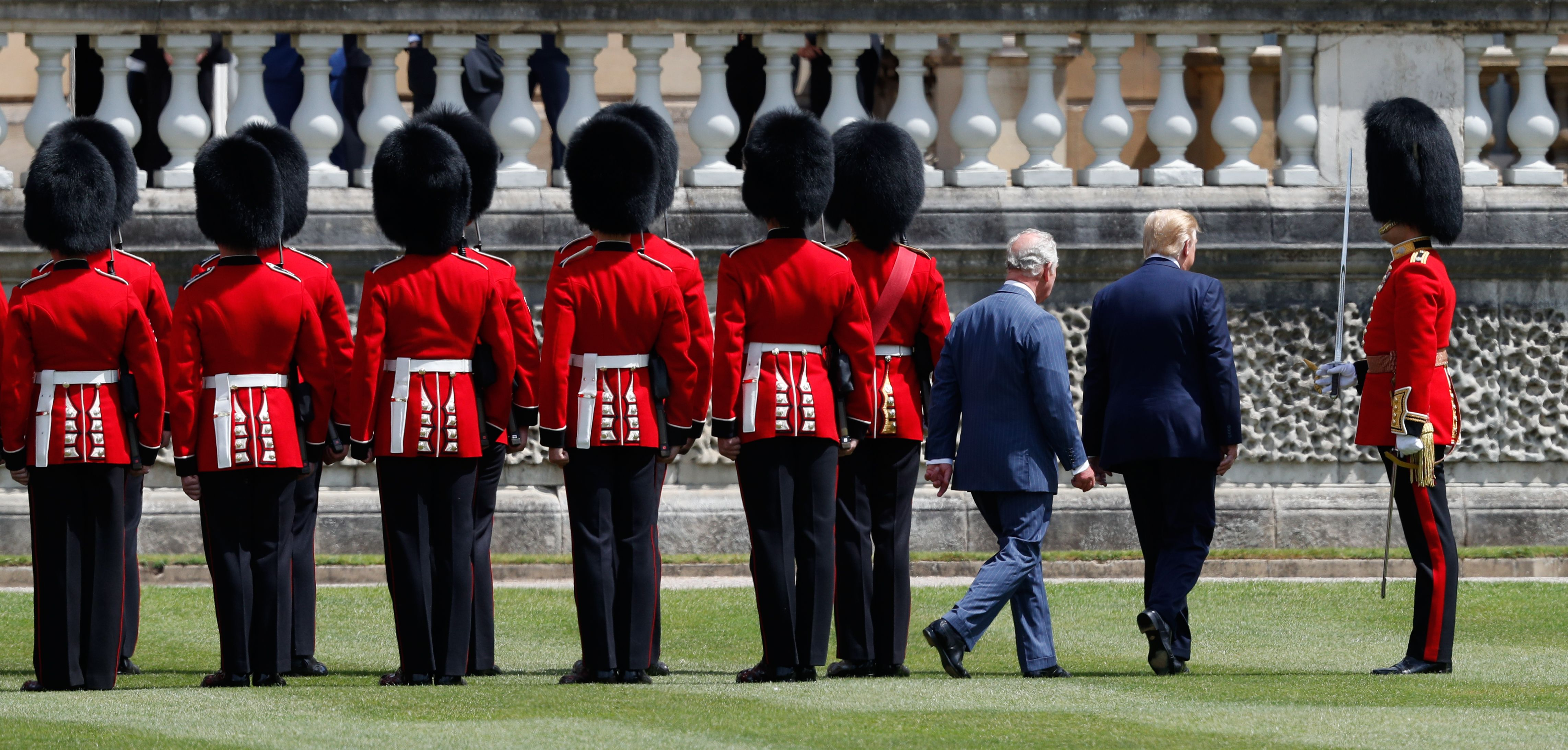 US President Donald Trump (2R) and Britain's Prince Charles, Prince of Wales (3R) inspects the guard of honour during a welcome ceremony at Buckingham Palace in central London on June 3, 2019, on the first day of the US president and First Lady's three-day State Visit to the UK. - Britain rolled out the red carpet for US President Donald Trump on June 3 as he arrived in Britain for a state visit already overshadowed by his outspoken remarks on Brexit. (Photo by Adrian DENNIS / AFP)        (Photo credit should read ADRIAN DENNIS/AFP/Getty Images)