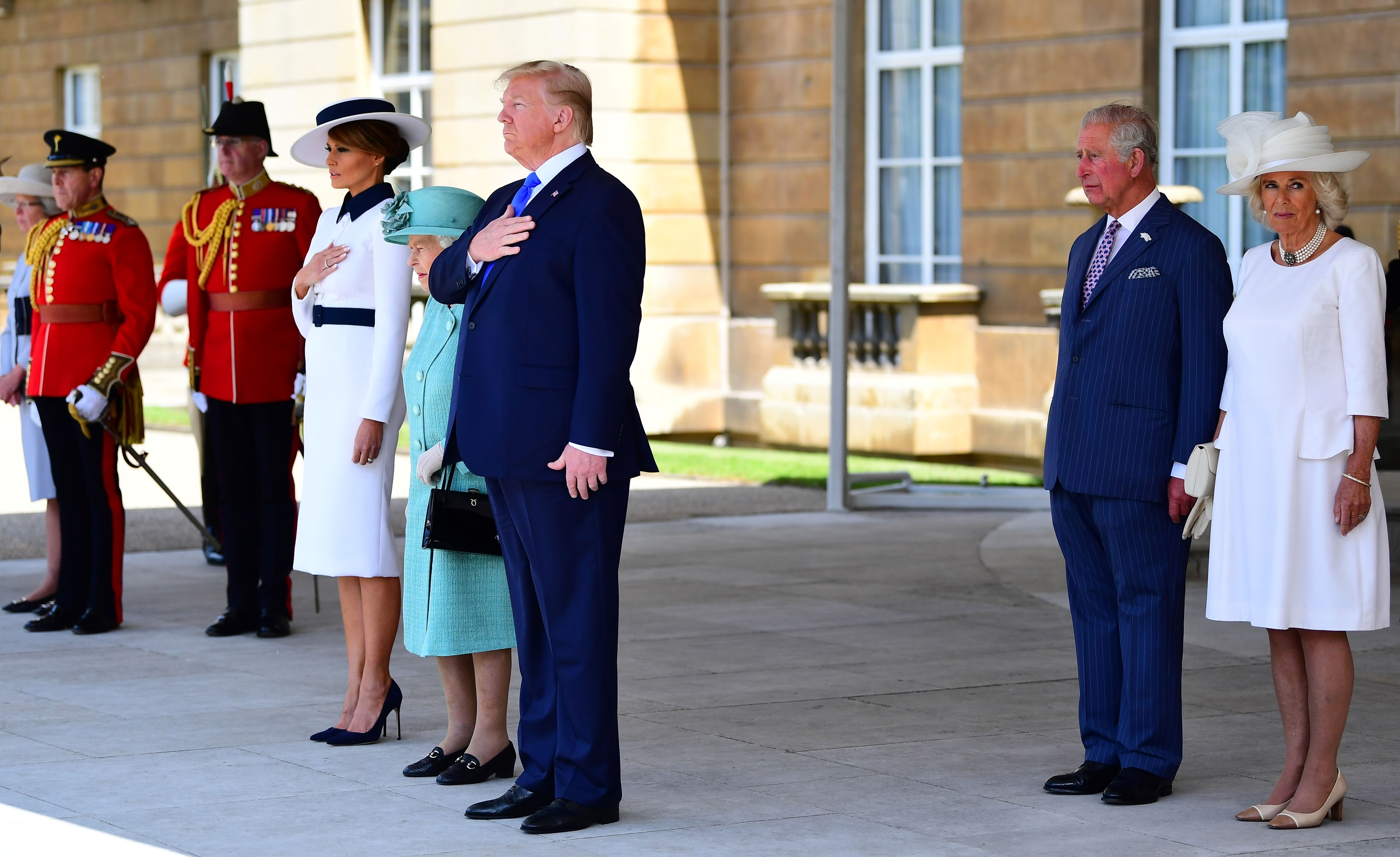 Britain's Queen Elizabeth II (4L) stands with US President Donald Trump (C), US First Lady Melania Trump (3L), Britain's Prince Charles, Prince of Wales (2R) and Britain's Camilla, Duchess of Cornwall as they listen to the US national anthem during a welcome ceremony at Buckingham Palace in central London on June 3, 2019, on the first day of the US president and First Lady's three-day State Visit to the UK. - Britain rolled out the red carpet for US President Donald Trump on June 3 as he arrived in Britain for a state visit already overshadowed by his outspoken remarks on Brexit. (Photo by Victoria Jones / POOL / AFP)        (Photo credit should read VICTORIA JONES/AFP/Getty Images)