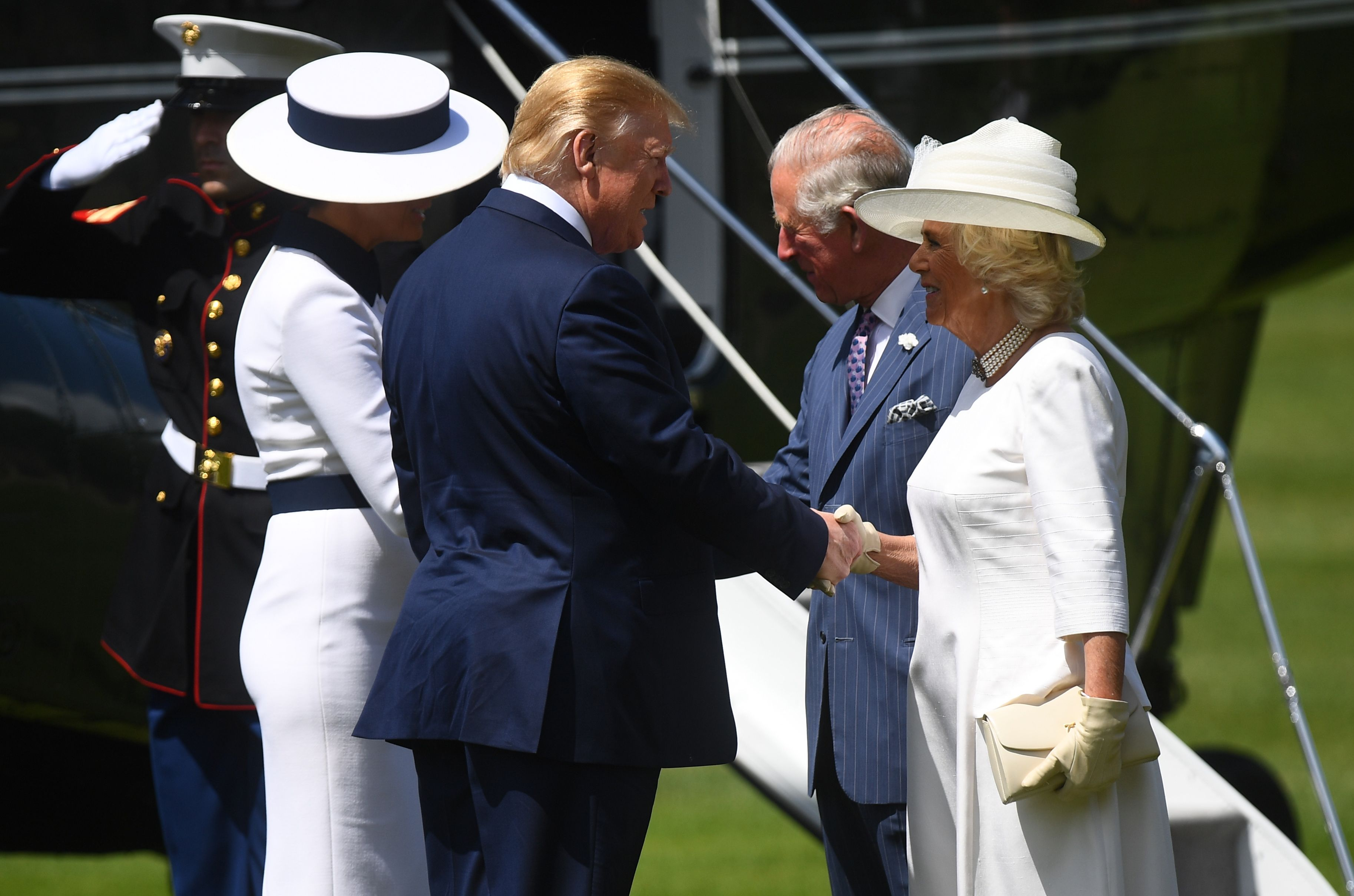 US President Donald Trump (C) and US First Lady Melania Trump (2L) are met by Britain's Prince Charles, Prince of Wales (2R) and Britain's Camilla, Duchess of Cornwall (R) after disembarking Marine One as they arrive for a welcome ceremony at Buckingham Palace in central London on June 3, 2019, on the first day of the US president and First Lady's three-day State Visit to the UK. - Britain rolled out the red carpet for US President Donald Trump on June 3 as he arrived in Britain for a state visit already overshadowed by his outspoken remarks on Brexit. (Photo by Victoria Jones / POOL / AFP)        (Photo credit should read VICTORIA JONES/AFP/Getty Images)