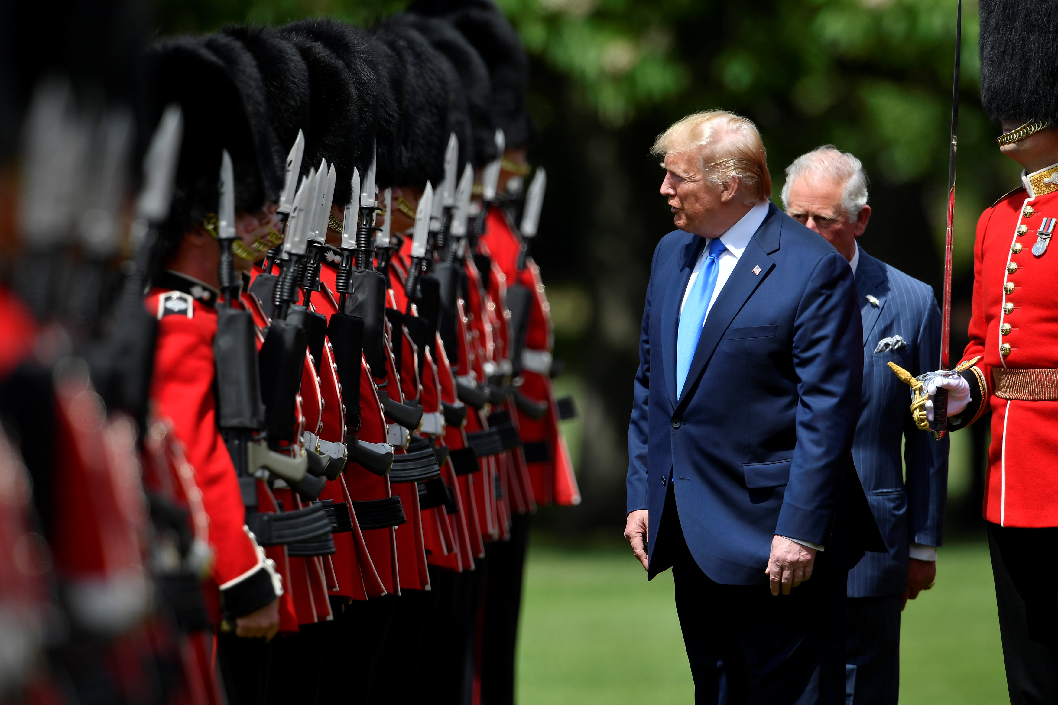 US President Donald Trump (L) inspects the honour guard with Britain's Prince Charles, Prince of Wales (R) during a welcome ceremony at Buckingham Palace in central London on June 3, 2019, on the first day of the US president and First Lady's three-day State Visit to the UK. - Britain rolled out the red carpet for US President Donald Trump on June 3 as he arrived in Britain for a state visit already overshadowed by his outspoken remarks on Brexit. (Photo by TOBY MELVILLE / POOL / AFP)        (Photo credit should read TOBY MELVILLE/AFP/Getty Images)