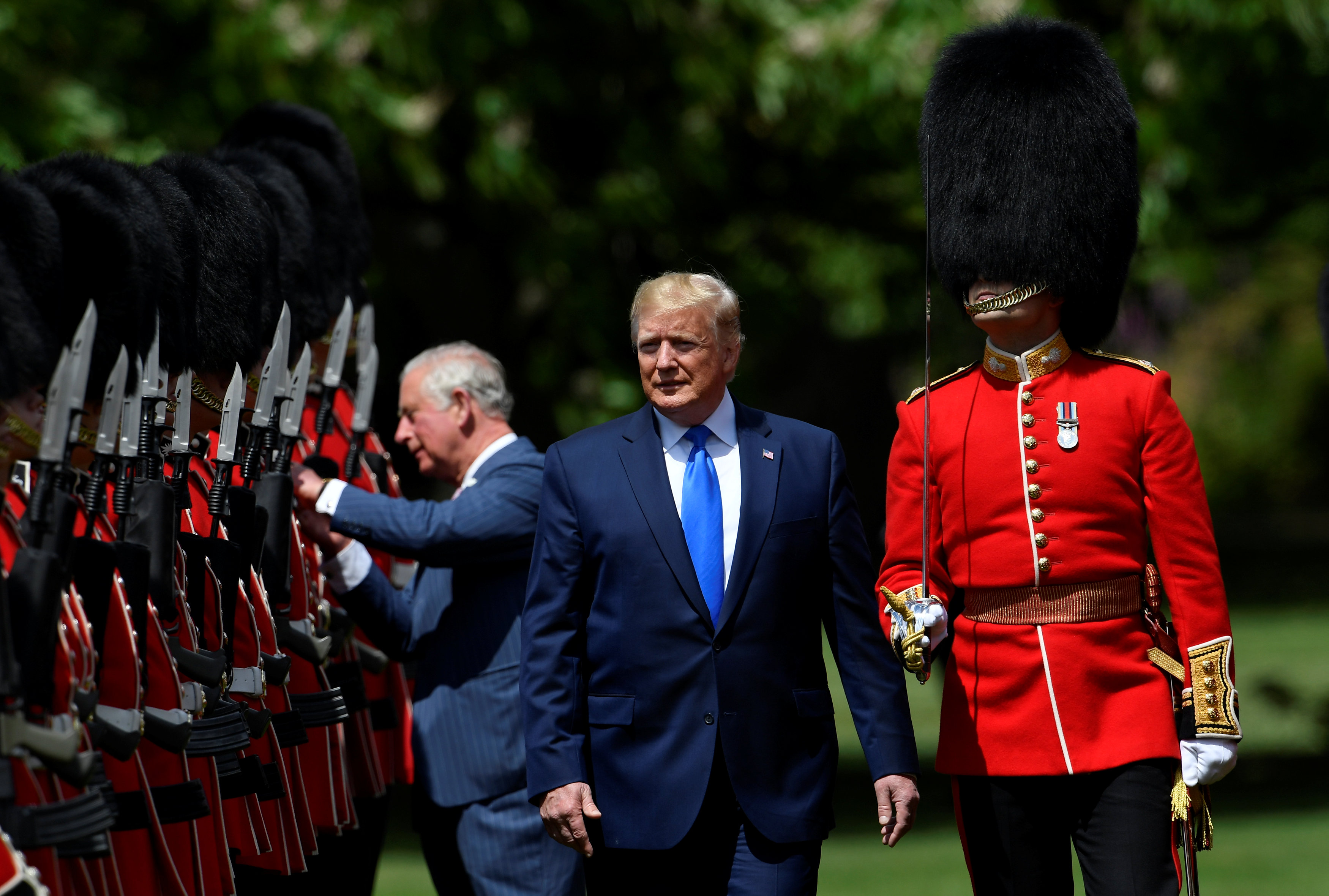 US President Donald Trump (R) inspects the honour guard with Britain's Prince Charles, Prince of Wales (L) during a welcome ceremony at Buckingham Palace in central London on June 3, 2019, on the first day of the US president and First Lady's three-day State Visit to the UK. - Britain rolled out the red carpet for US President Donald Trump on June 3 as he arrived in Britain for a state visit already overshadowed by his outspoken remarks on Brexit. (Photo by TOBY MELVILLE / POOL / AFP)        (Photo credit should read TOBY MELVILLE/AFP/Getty Images)