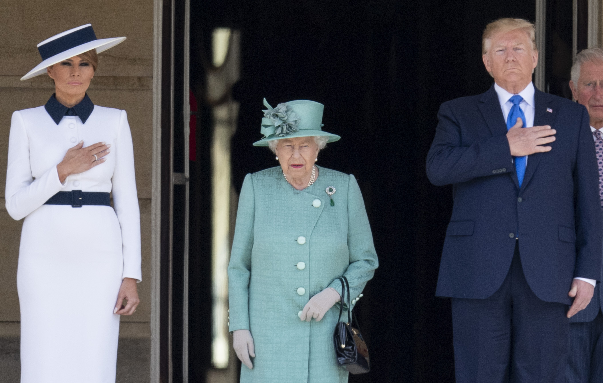 LONDON, ENGLAND - JUNE 03: Queen Elizabeth II with U.S. President Donald Trump and First Lady Melania Trump during the Ceremonial Welcome in the Buckingham Palace Garden on June 3, 2019 in London, England. (Photo by Mark Cuthbert/UK Press via Getty Images)