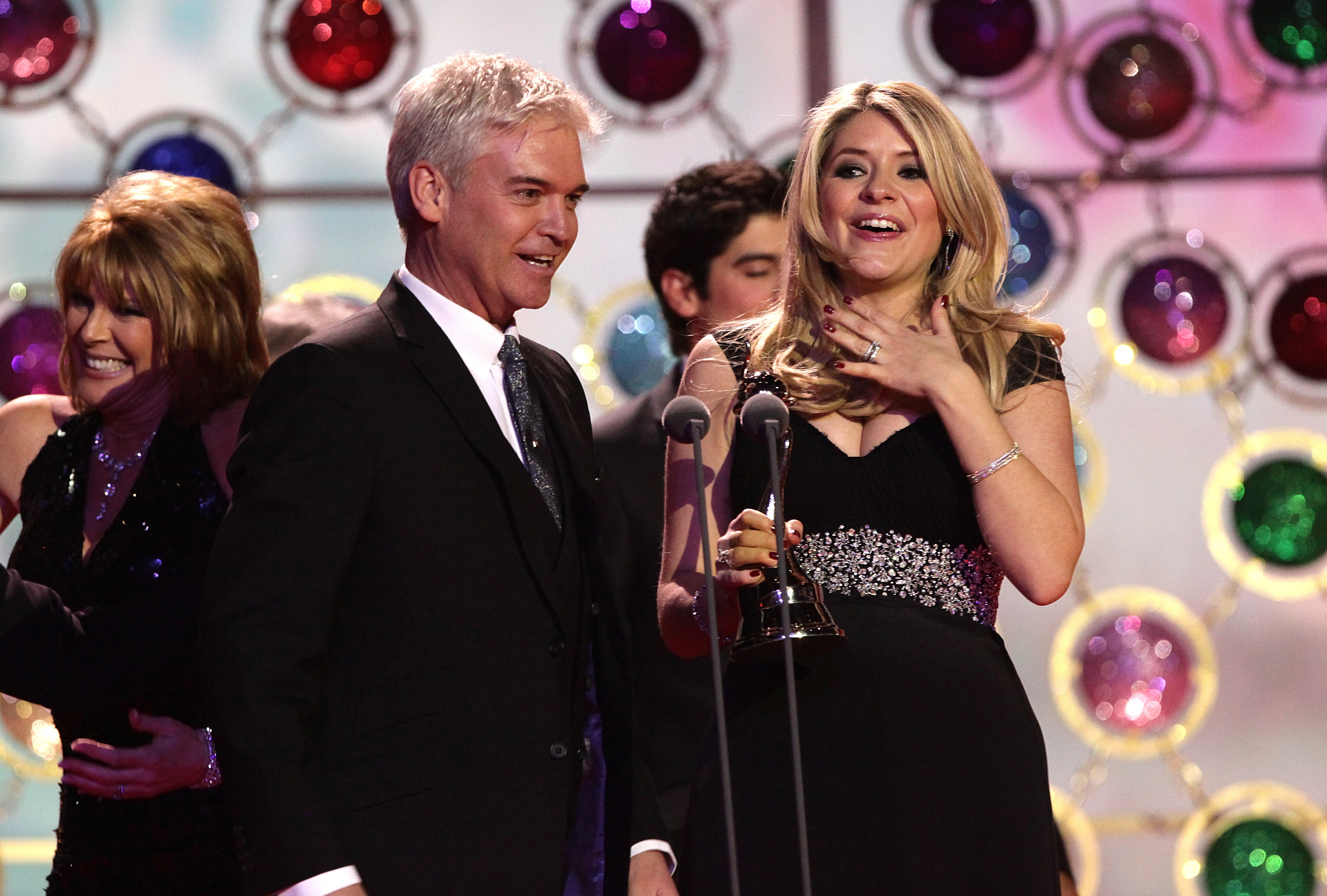 Phillip Schofield and Holly Willoughby on stage collecting the award for Best Magazine during the 2011 National Television Awards at the O2 Arena, London.