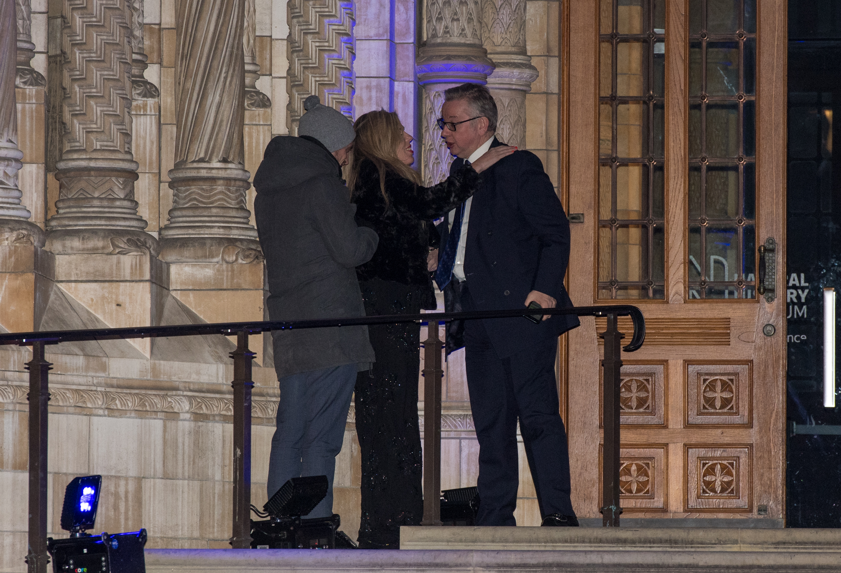 LONDON, ENGLAND - FEBRUARY 07:  Environment Secretary, Michael Gove hugs Carrie Symonds as he leaves the Conservative party Black and White Ball at Natural History Museum on February 7, 2018 in London, England. The ball is a fundraising event for the political party where donors pay to spend the evening with cabinet ministers and the Prime Minister.  (Photo by Chris J Ratcliffe/Getty Images)