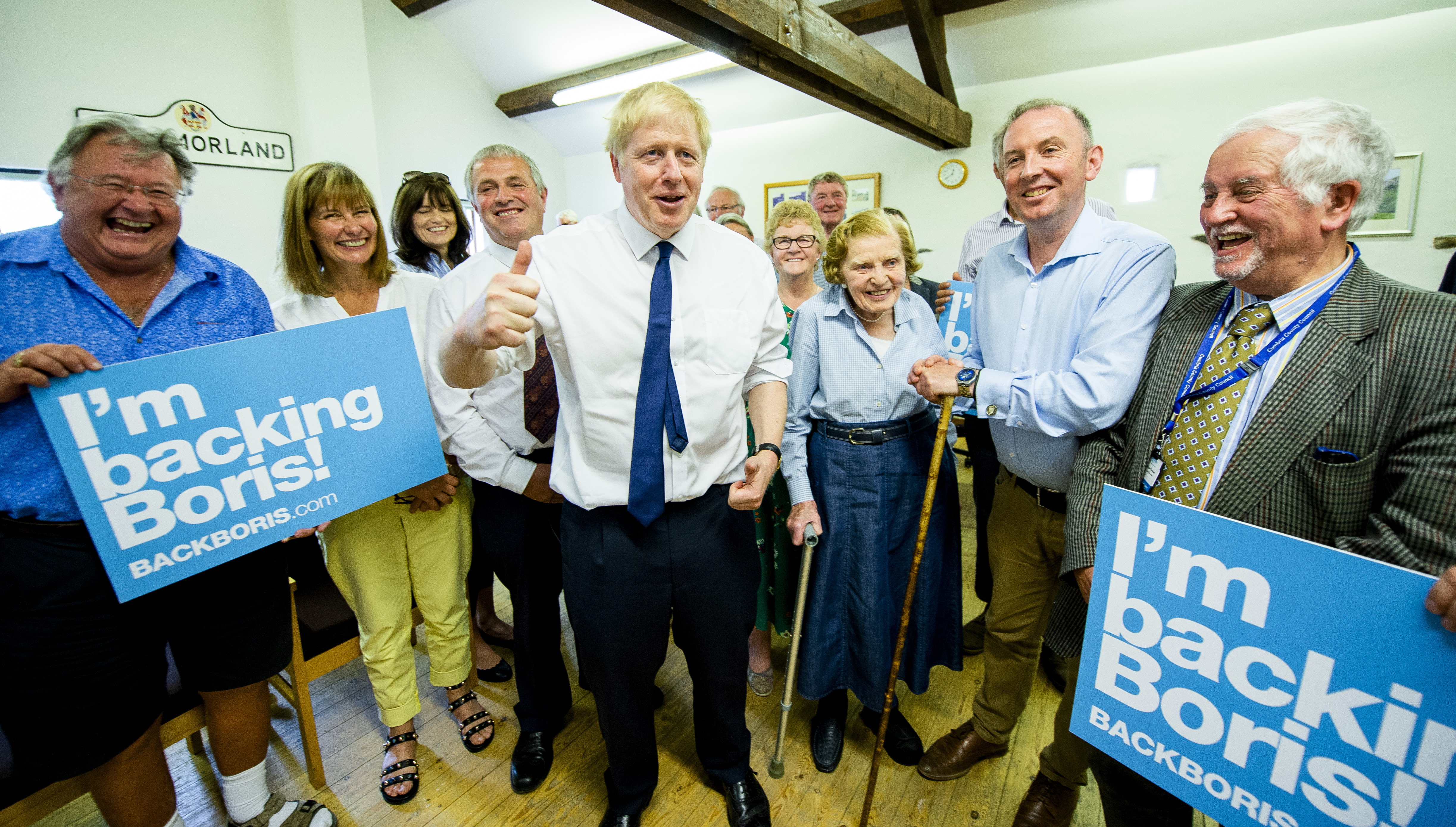 Conservative party leadership contender Boris Johnson with a supporter at a Tory leadership hustings in Crooklands in Cumbria.