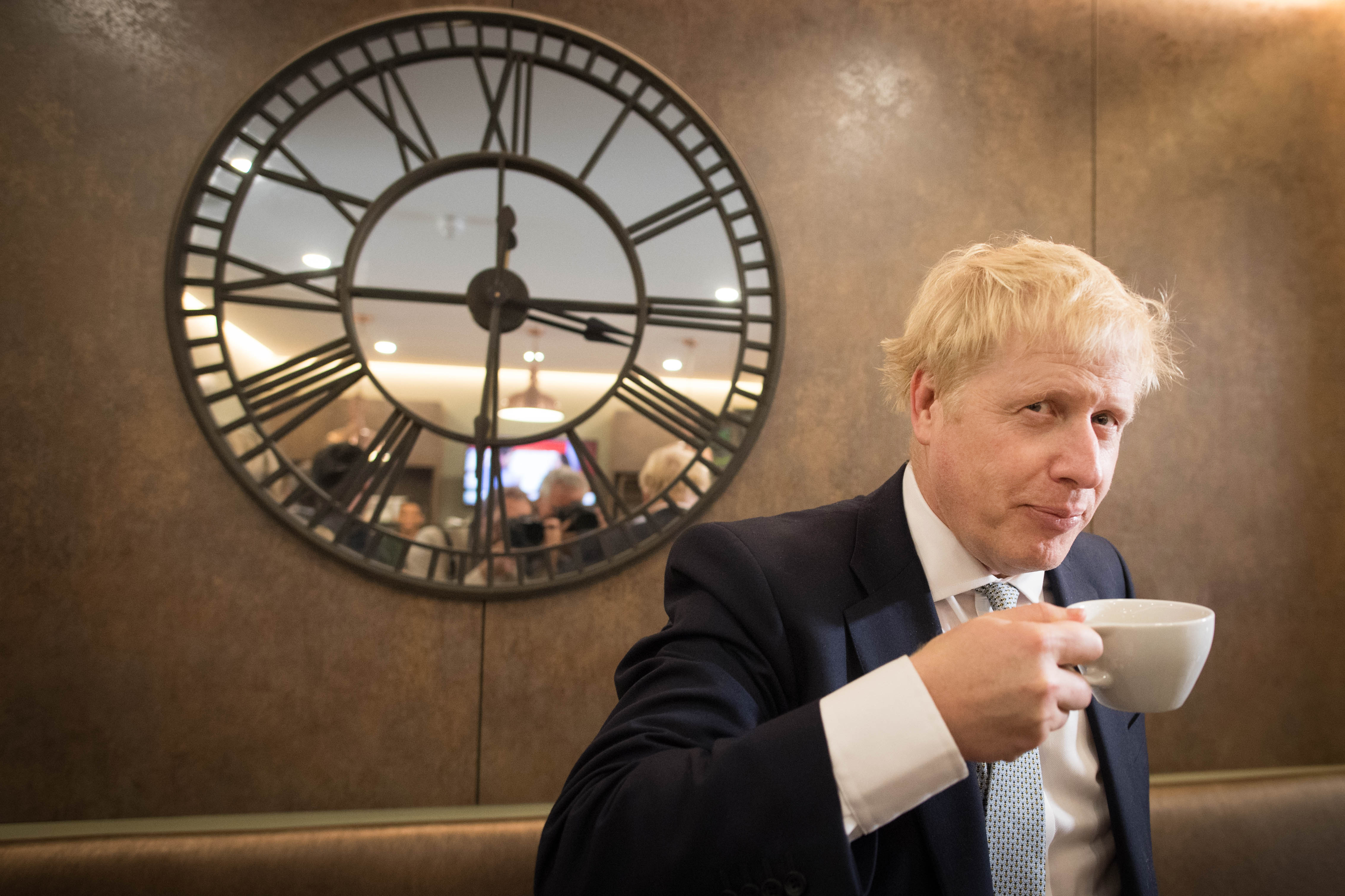 Conservative party leadership candidate Boris Johnson has a drink in the Munch and Wiggles cafe in Oxshott, Surrey.