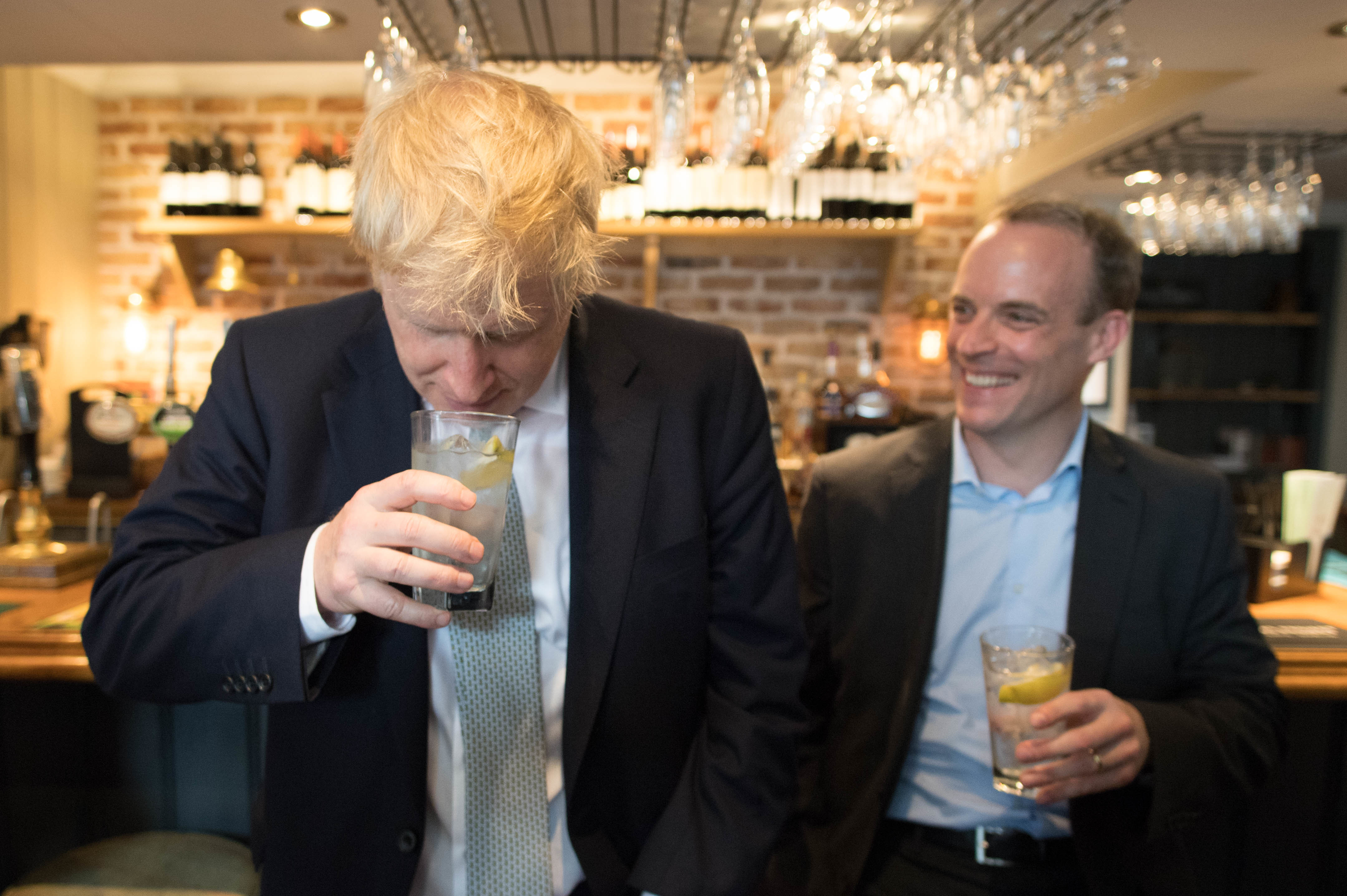 Conservative party leadership candidate Boris Johnson (left) and Dominic Rabb in The Victoria public house in Oxshott, Surrey.