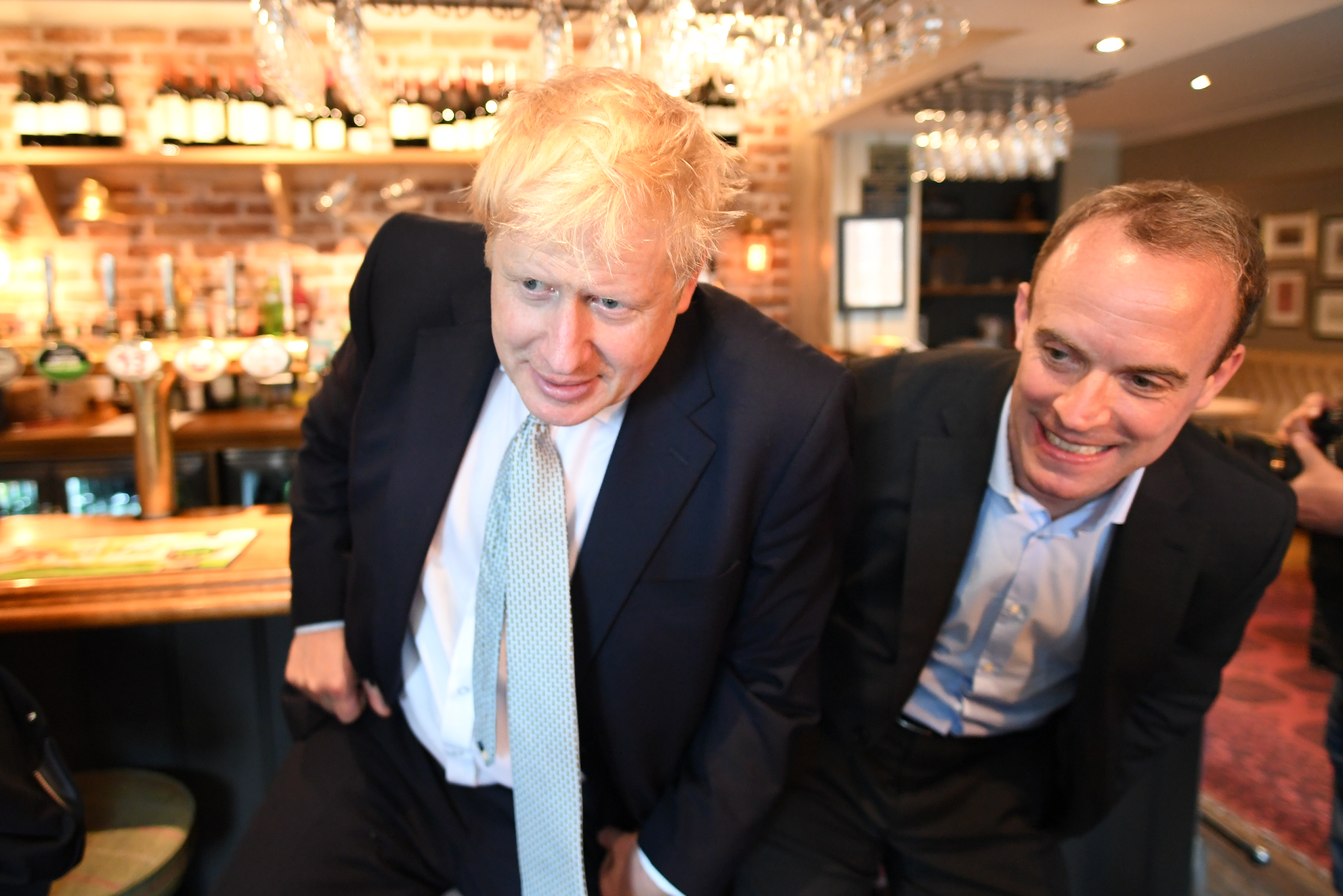 Conservative party leadership candidate Boris Johnson (left) and Dominic Rabb, in The Victoria public house in Oxshott, Surrey.