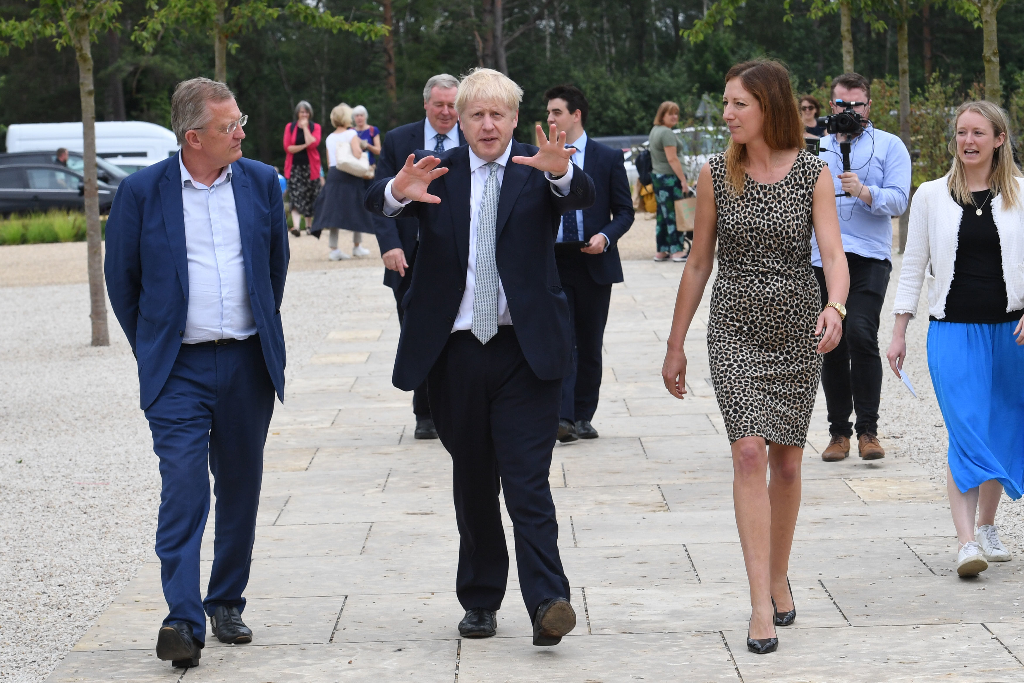RETRANSMISSION adding name of Hayley Monckton. Conservative party leadership candidate Boris Johnson (centre) walks with David Alexander (left, Director of Estates at the RHS) and Hayley Monckton (front right, Director of Communications at the RHS) while touring the RHS (Royal Horticultural Society) garden at Wisley, in Surrey.