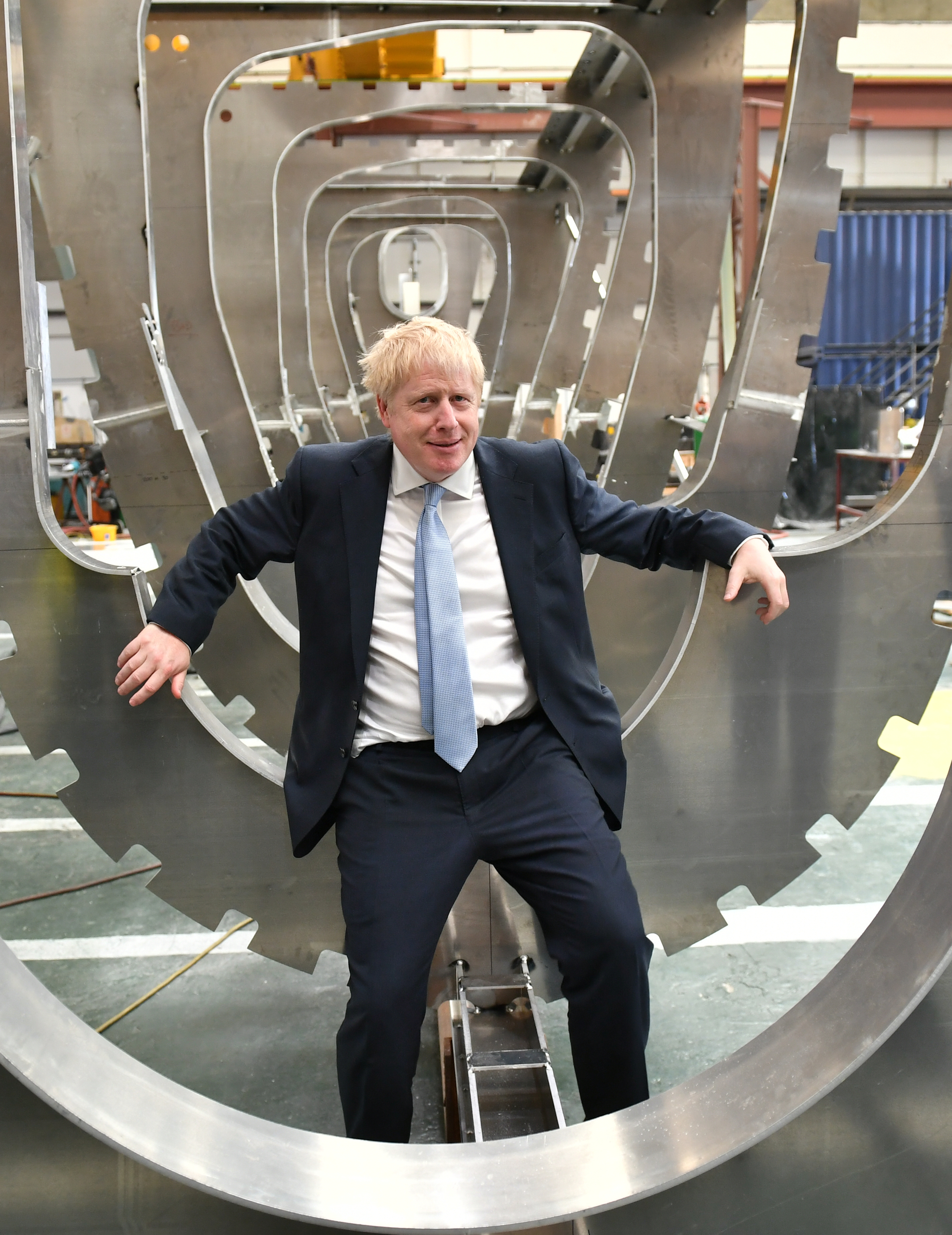 Conservative party leadership contender Boris Johnson sits in a boat under construction at the Venture Quay boatyard during a visit to the Isle of Wight.