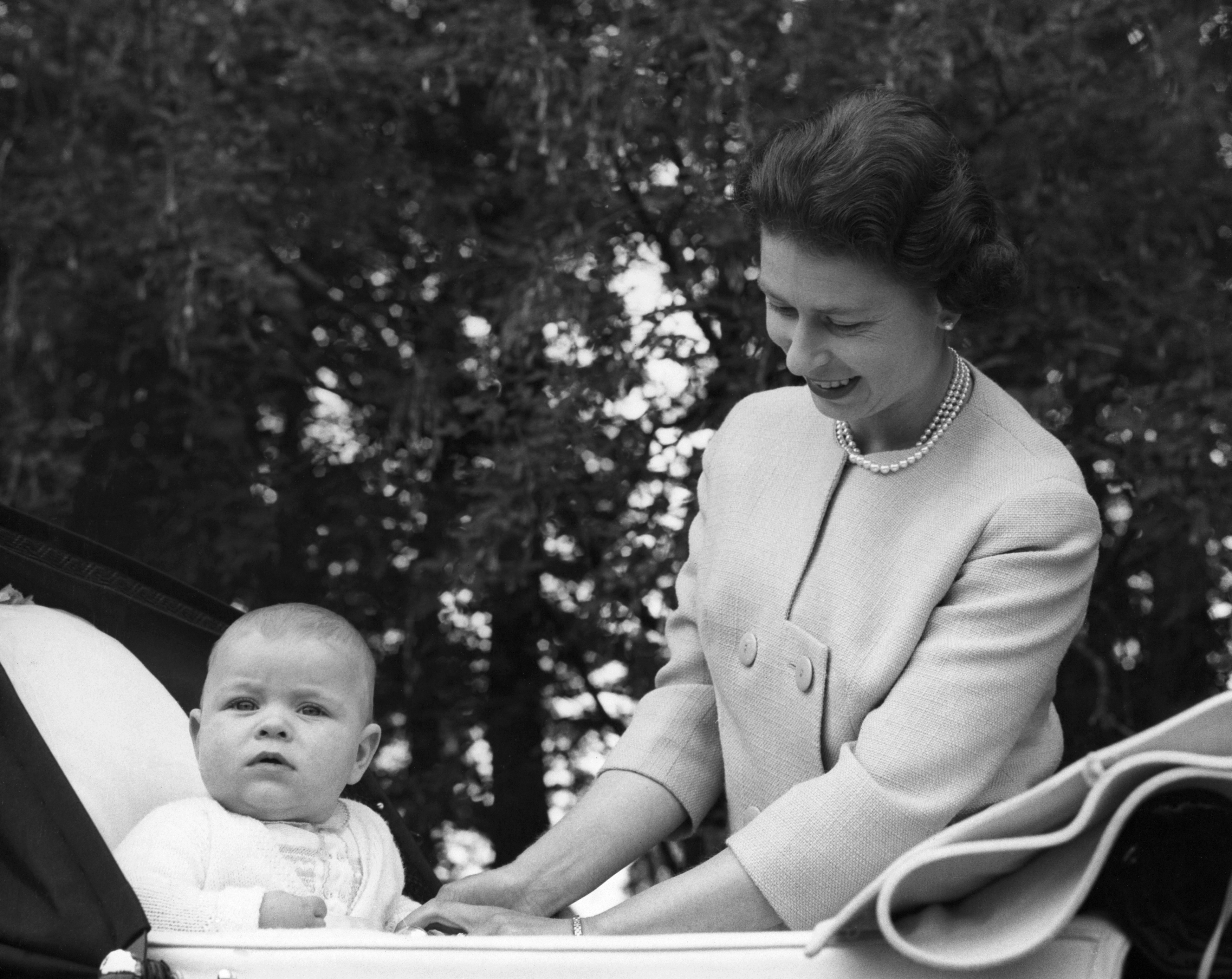 Queen Elizabeth with her second son Prince Andrew, in his pram at Balmoral Castle, 1961. (Photo by © Hulton-Deutsch Collection/CORBIS/Corbis via Getty Images)
