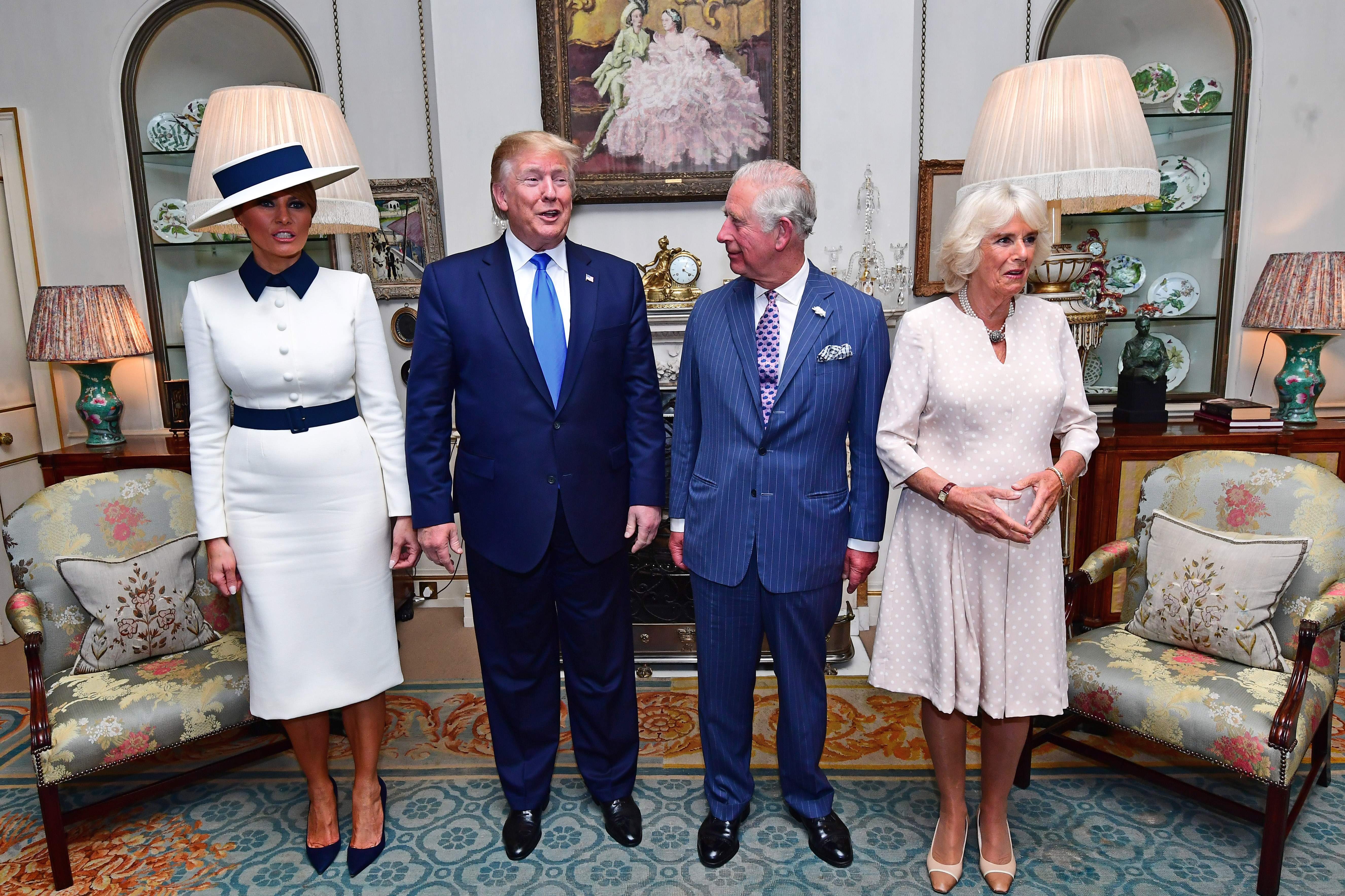 LONDON, ENGLAND - JUNE 03: U.S. President Donald Trump (2nd L) and his wife Melania Trump (L)  take tea with Prince Charles, Prince of Wales (2nd R) and Camilla, Duchess of Cornwall (R) at Clarence House on June 3, 2019 in London, England. President Trump's three-day state visit will include lunch with the Queen, and a State Banquet at Buckingham Palace, as well as business meetings with the Prime Minister and the Duke of York, before travelling to Portsmouth to mark the 75th anniversary of the D-Day landings.  (Photo by Victoria Jones - WPA Pool/Getty Images)