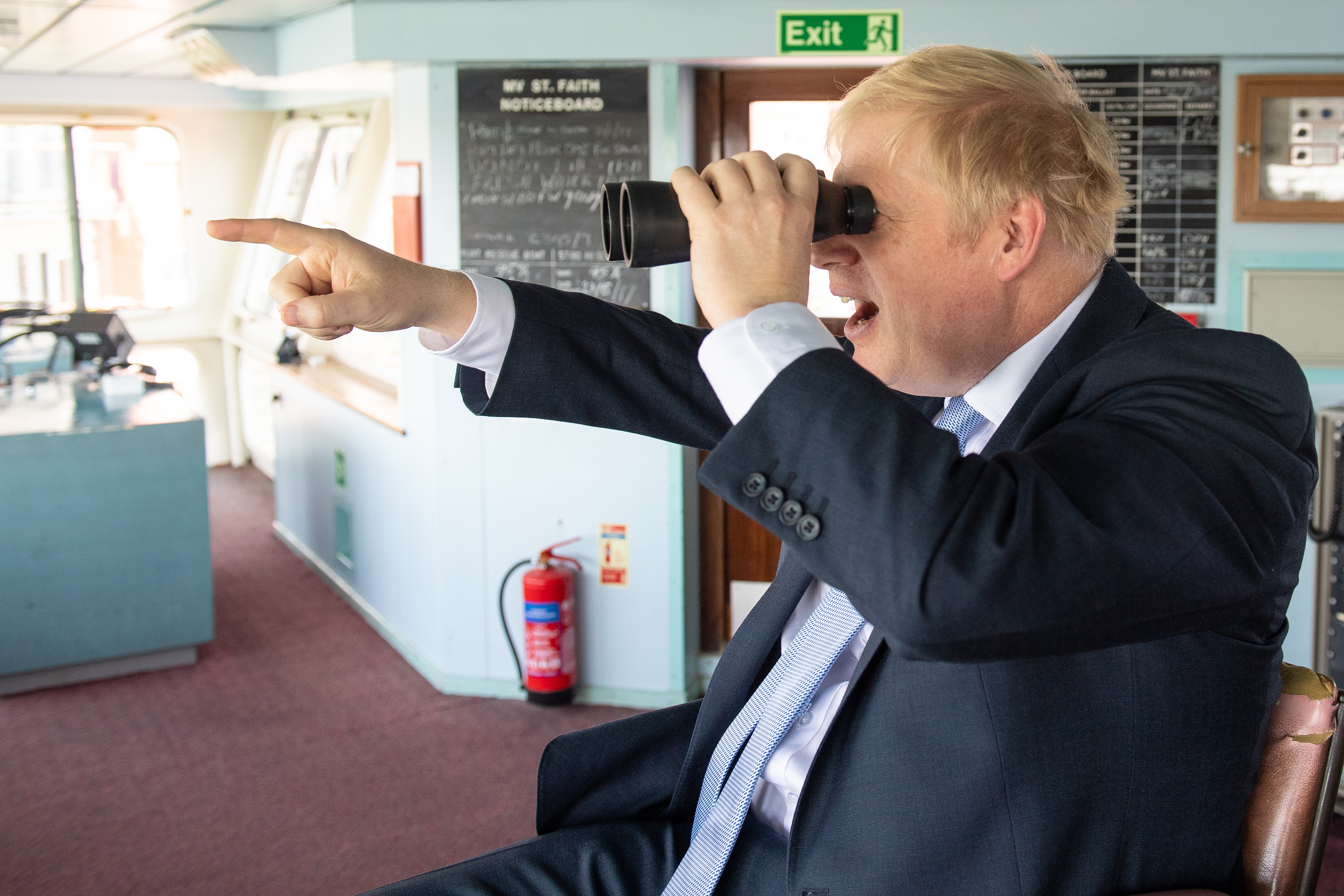 Conservative leadership candidate Boris Johnson looks through binoculars on the bridge of the Isle of Wight ferry as it sets sail from Portsmouth.