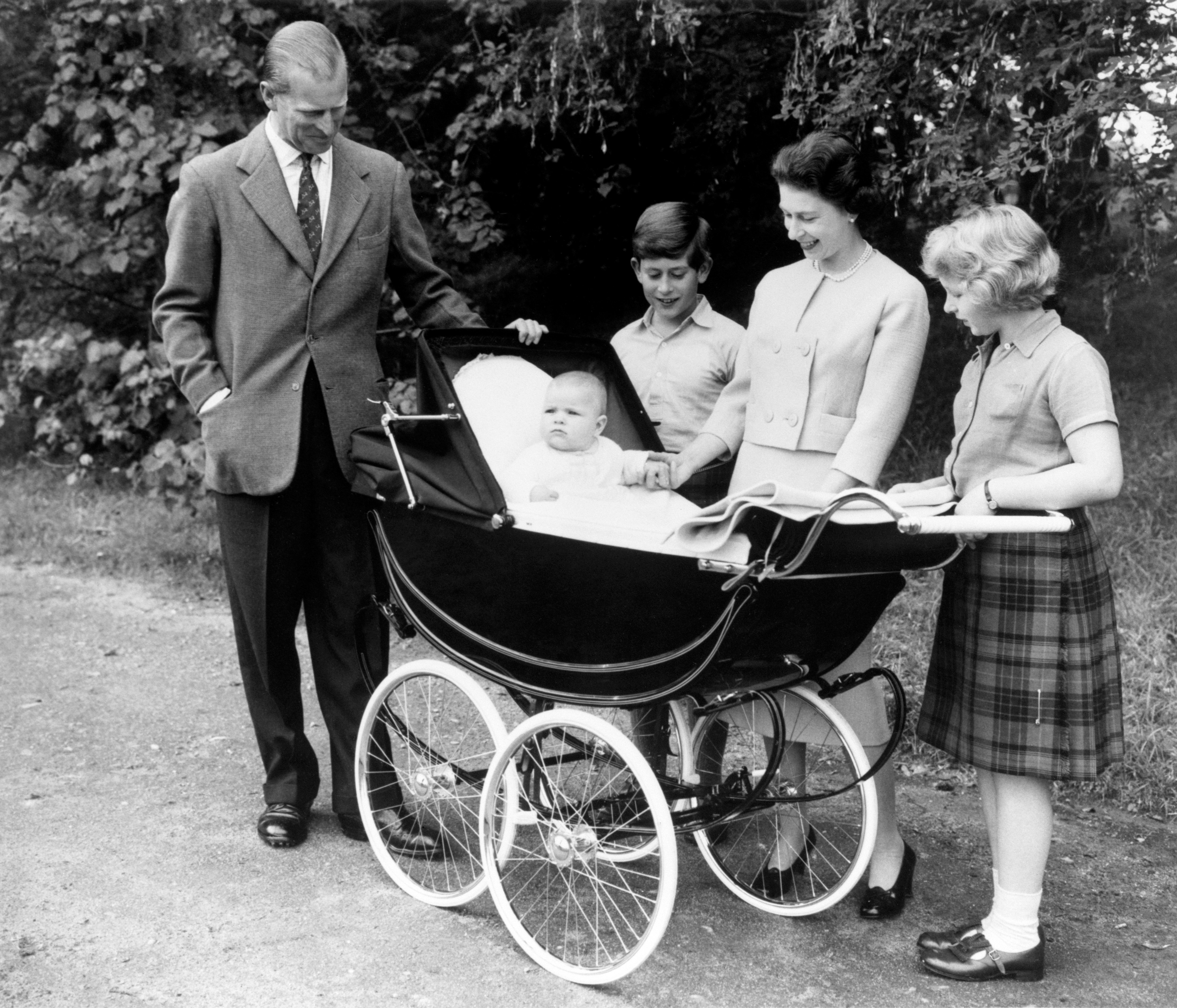 Surrounded by members of the Royal Family, Prince Andrew sits up and takes an interest in the proceedings from the comfort of his pram, in the Balmoral Estate.   (Photo by PA Images via Getty Images)
