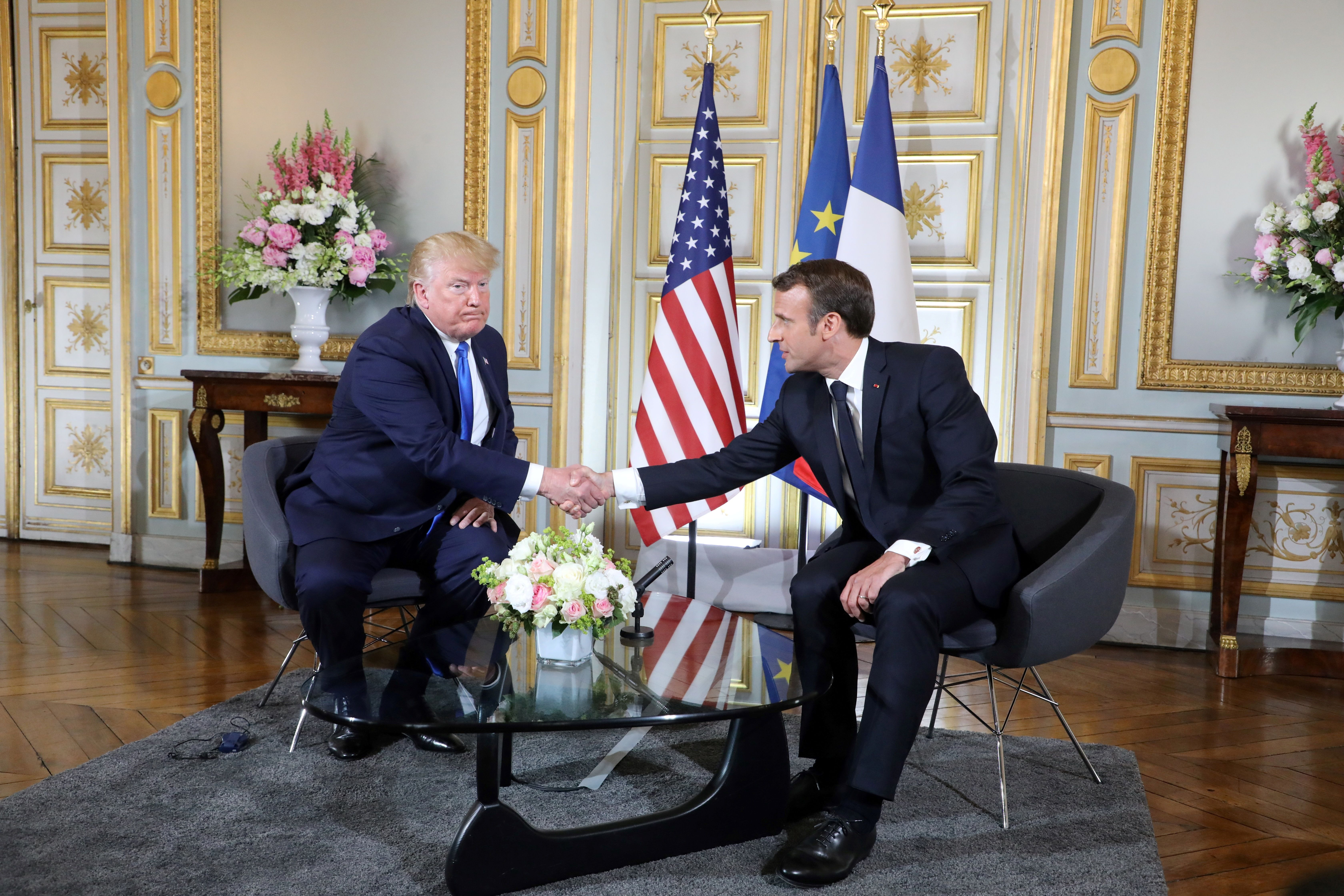 US President Donald Trump (L) shakes hands during a meeting with the French President Emmanuel Macron at the Prefecture of Caen, Normandy, north-western France, on June 6, 2019, on the sidelines of D-Day commemorations marking the 75th anniversary of the World War II Allied landings in Normandy. (Photo by Ludovic MARIN / POOL / AFP)        (Photo credit should read LUDOVIC MARIN/AFP/Getty Images)