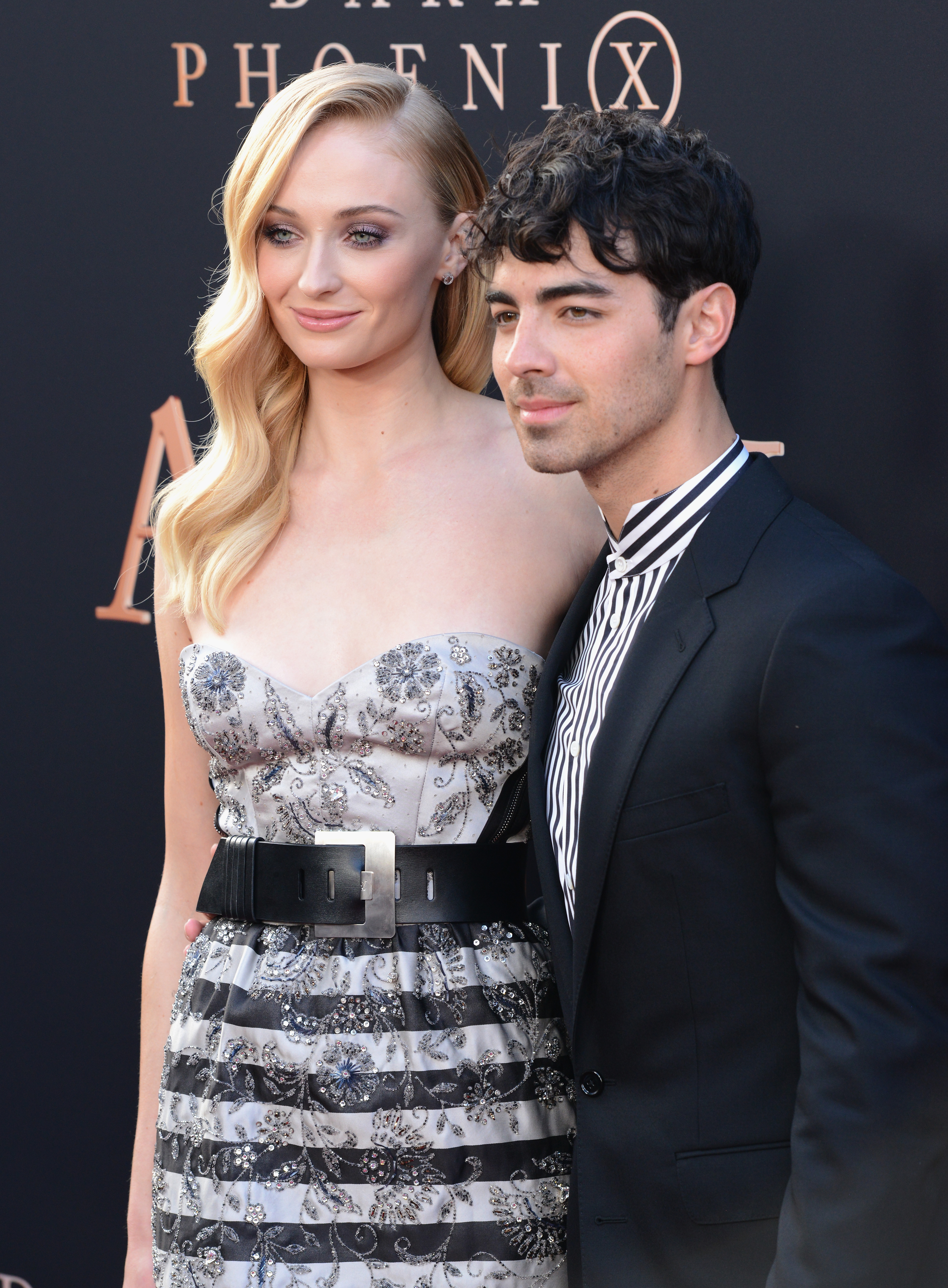 """HOLLYWOOD, CA - JUNE 04:  Sophie Turner and Joe Jonas arrive for the Premiere Of 20th Century Fox's """"Dark Phoenix""""  held at TCL Chinese Theatre on June 4, 2019 in Hollywood, California.  (Photo by Albert L. Ortega/Getty Images)"""