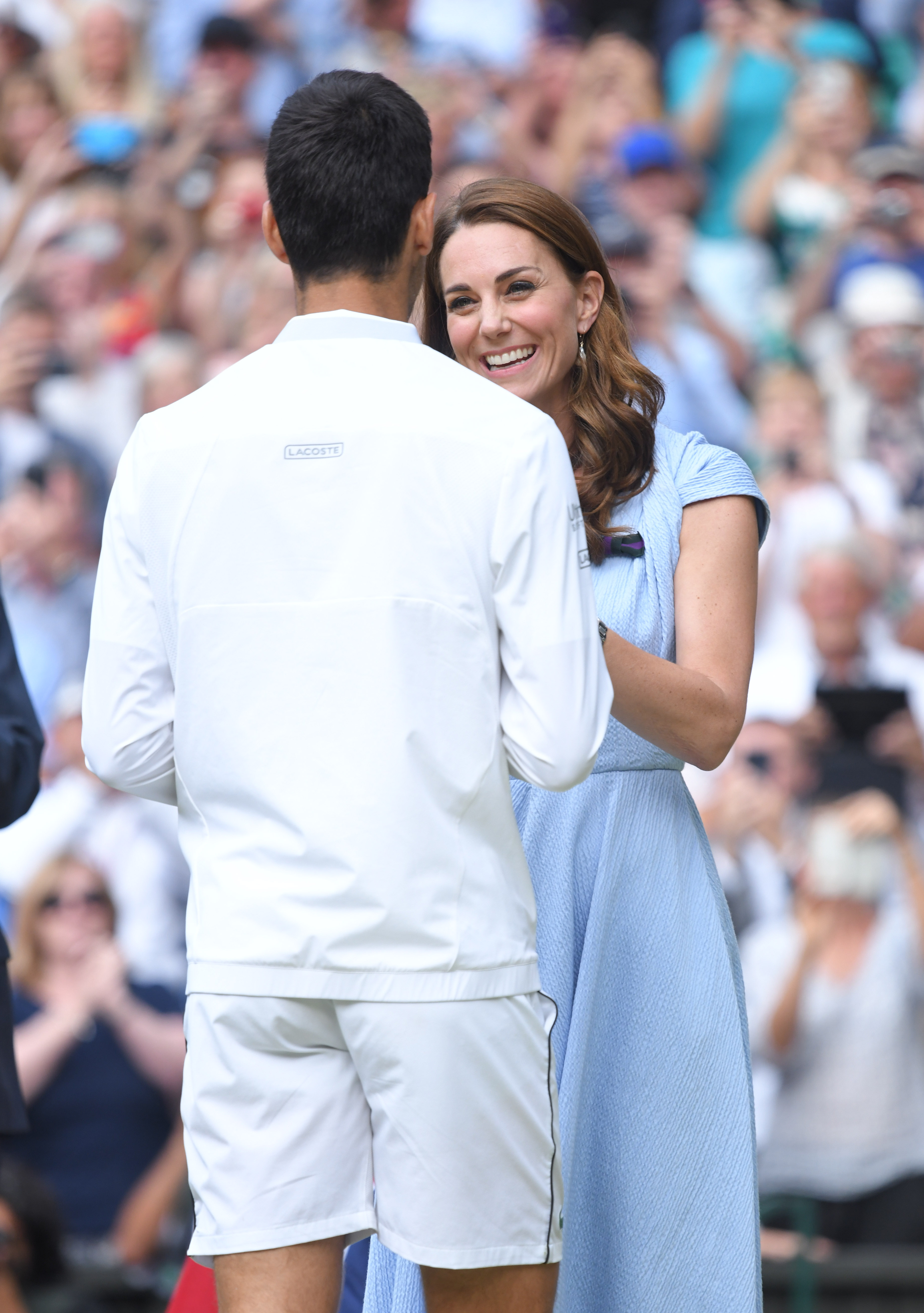 LONDON, ENGLAND - JULY 14: Catherine, Duchess of Cambridge presents Novak Djokovic with the winner's trophy after winning his Men's Singles final against Roger Federer of Switzerland during Day thirteen of the Wimbledon Tennis Championships at All England Lawn Tennis and Croquet Club on July 14, 2019 in London, England. (Photo by Karwai Tang/Getty Images)