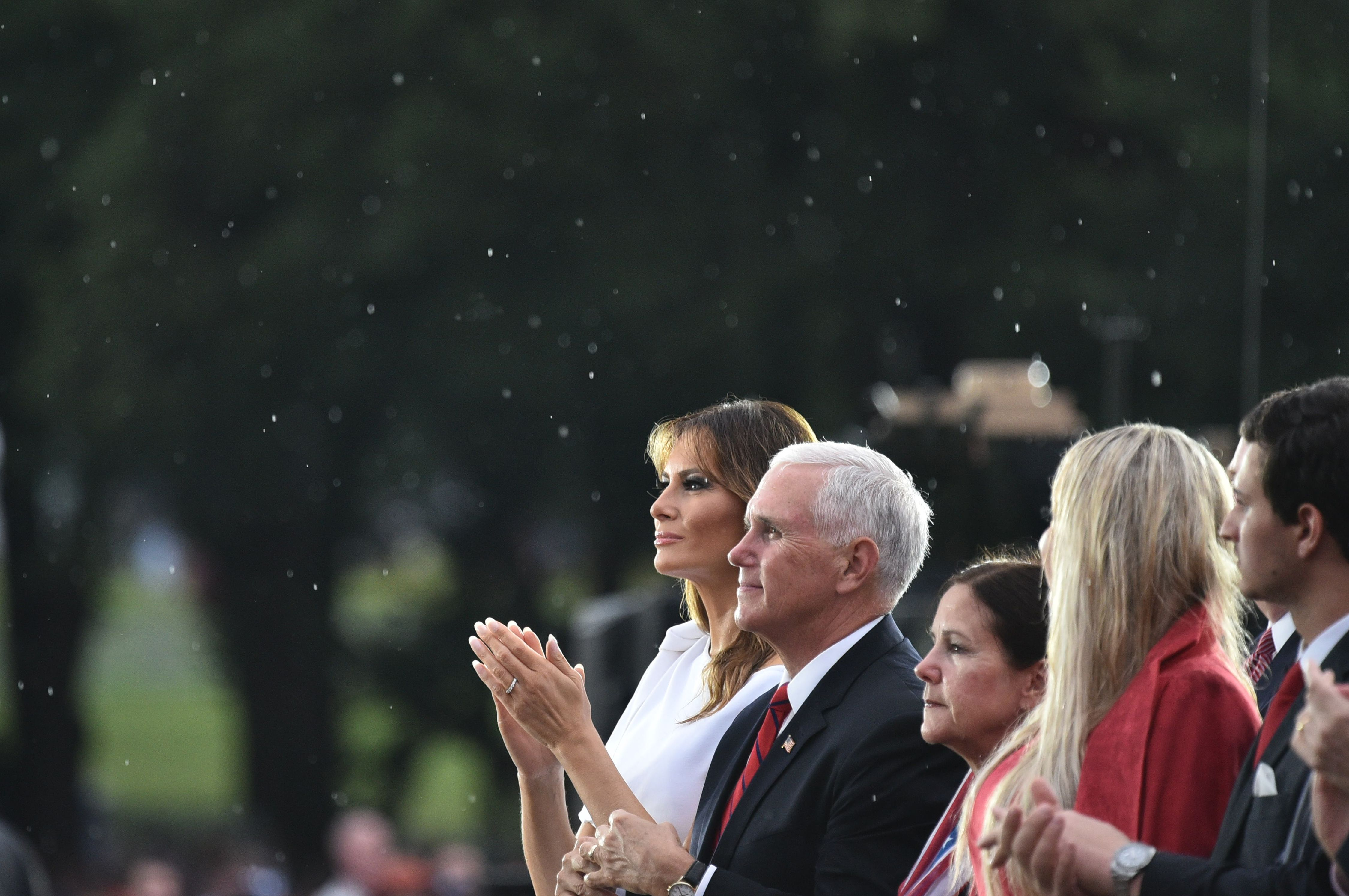 """US First Lady Melania Trump and Vice President Mike Pence applaud during the """"Salute to America"""" Fourth of July event at the Lincoln Memorial in Washington, DC, July 4, 2019. (Photo by MANDEL NGAN / AFP)        (Photo credit should read MANDEL NGAN/AFP/Getty Images)"""