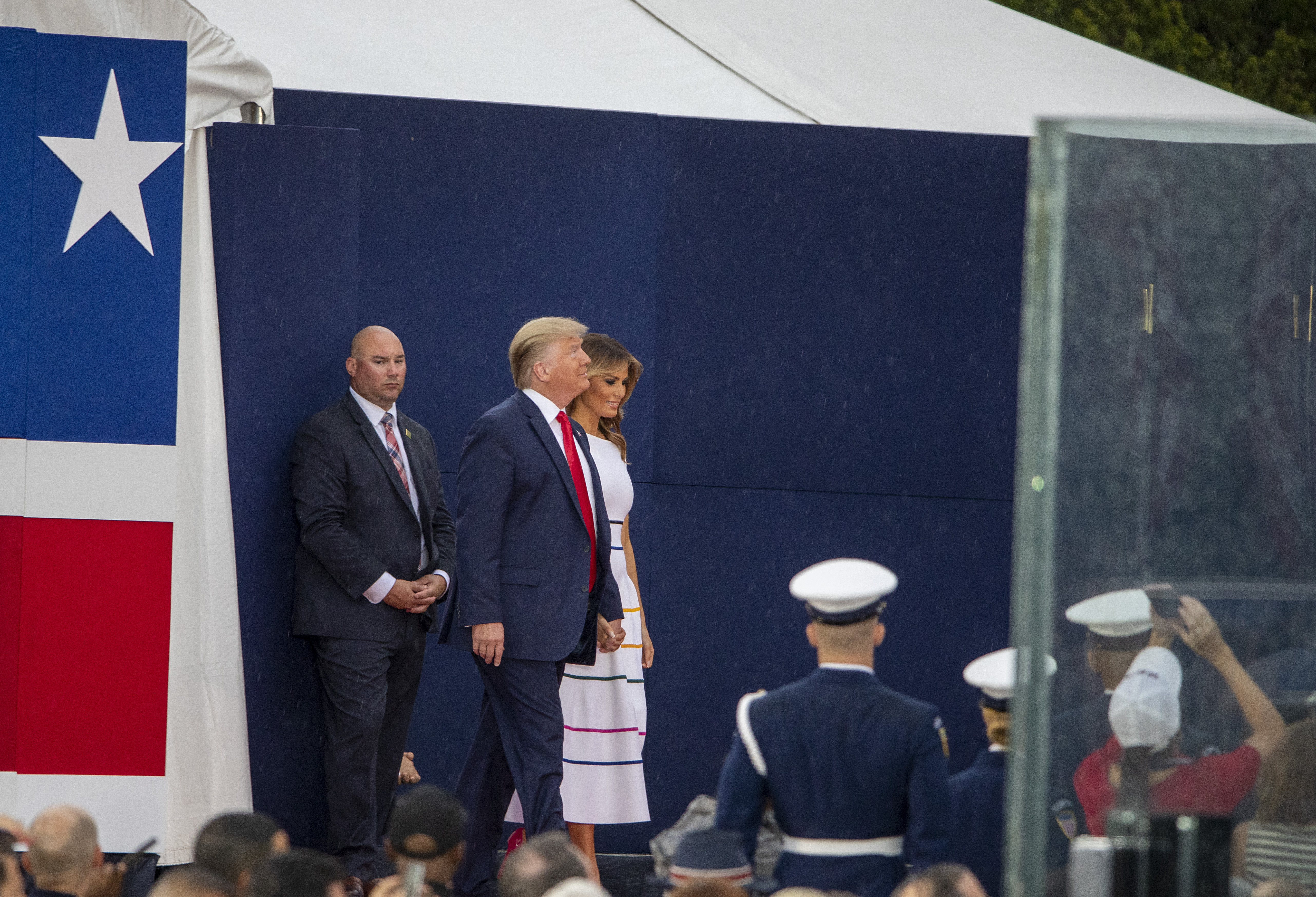 """WASHINGTON, DC - JULY 04: President Donald Trump and first lady Melania Trump take the stage on July 04, 2019 in Washington, DC. President Trump is holding a """"Salute to America"""" celebration on the National Mall on Independence Day this year with musical performances, a military flyover, and fireworks. (Photo by Tasos Katopodis/Getty Images)"""