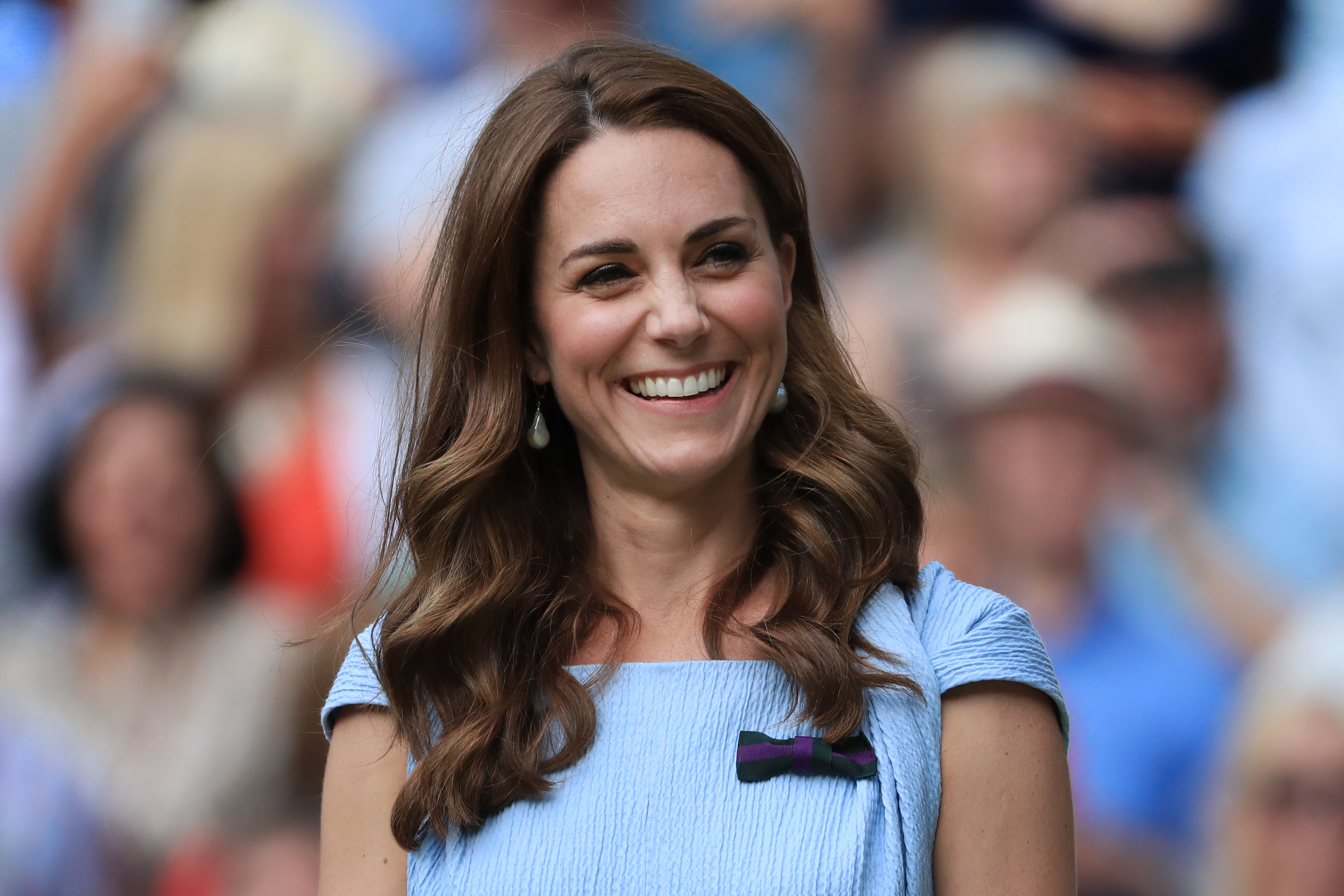LONDON, ENGLAND - JULY 14: Catherine, Duchess of Cambridge laughs and smiles on Day 13 of The Championships - Wimbledon 2019 at the All England Lawn Tennis and Croquet Club on July 14, 2019 in London, England. (Photo by Simon Stacpoole/Offside/Getty Images)