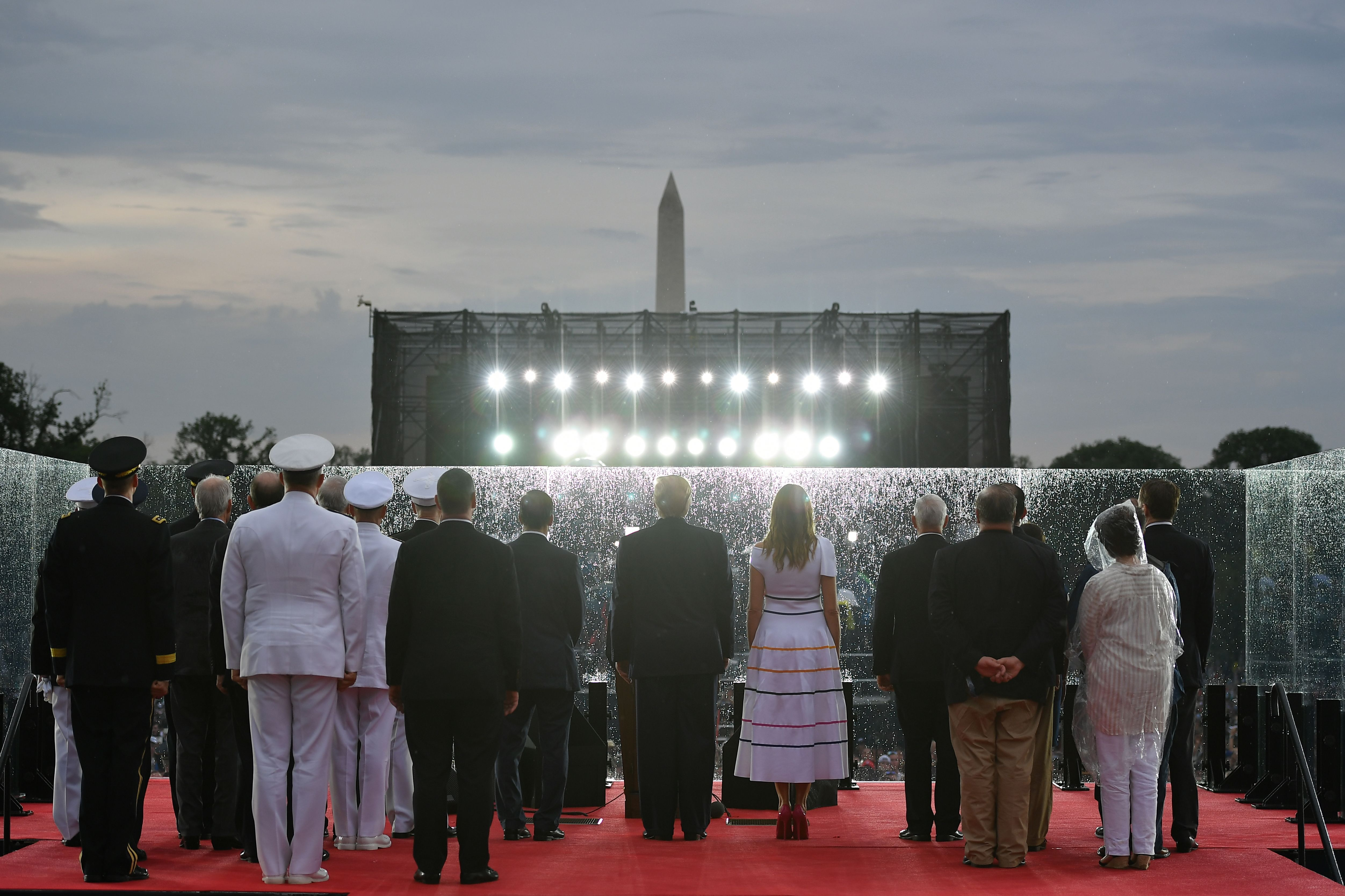 """US President Donald Trump (C-L) and First Lady Melania Trump stand onstage with others during the """"Salute to America"""" Fourth of July event at the Lincoln Memorial in Washington, DC, July 4, 2019. (Photo by MANDEL NGAN / AFP)        (Photo credit should read MANDEL NGAN/AFP/Getty Images)"""