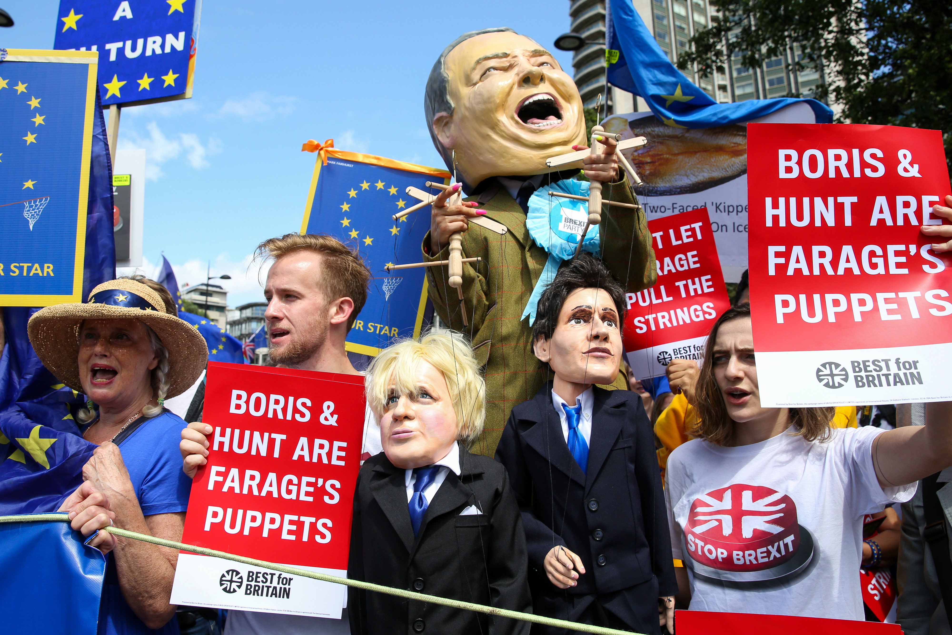 A stilts-walker wearing a giant Nigel Farage's head pulling two puppets, the Conservative leadership candidates Boris Johnson and Jeremy Hunt, during the �No to Boris. Yes to Europe� march in central London. (Photo by Dinendra Haria / SOPA Images/Sipa USA)