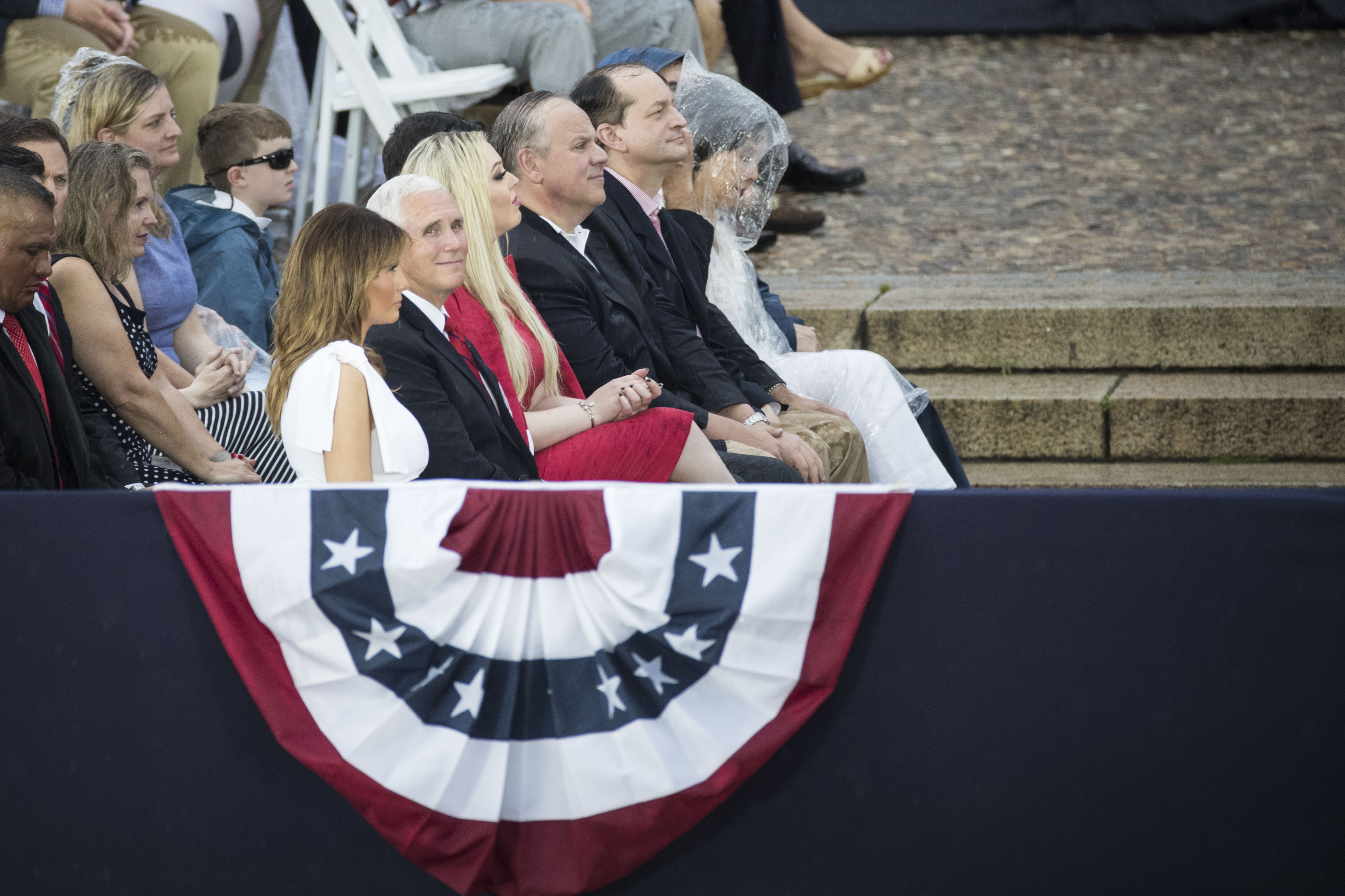"""WASHINGTON, DC - JULY 04: First Lady Melania Trump, Vice President Mike Pence, Second Lady Karen Pence and Tiffany Trump listen as President Donald Trump delivers remarks at the """"Salute to America"""" ceremony in front of the Lincoln Memorial, on July 4, 2019 in Washington, DC. The presentation featured armored vehicles on display, a flyover by Air Force One, and several flyovers by other military aircraft. (Photo by Sarah Silbiger/Getty Images)"""