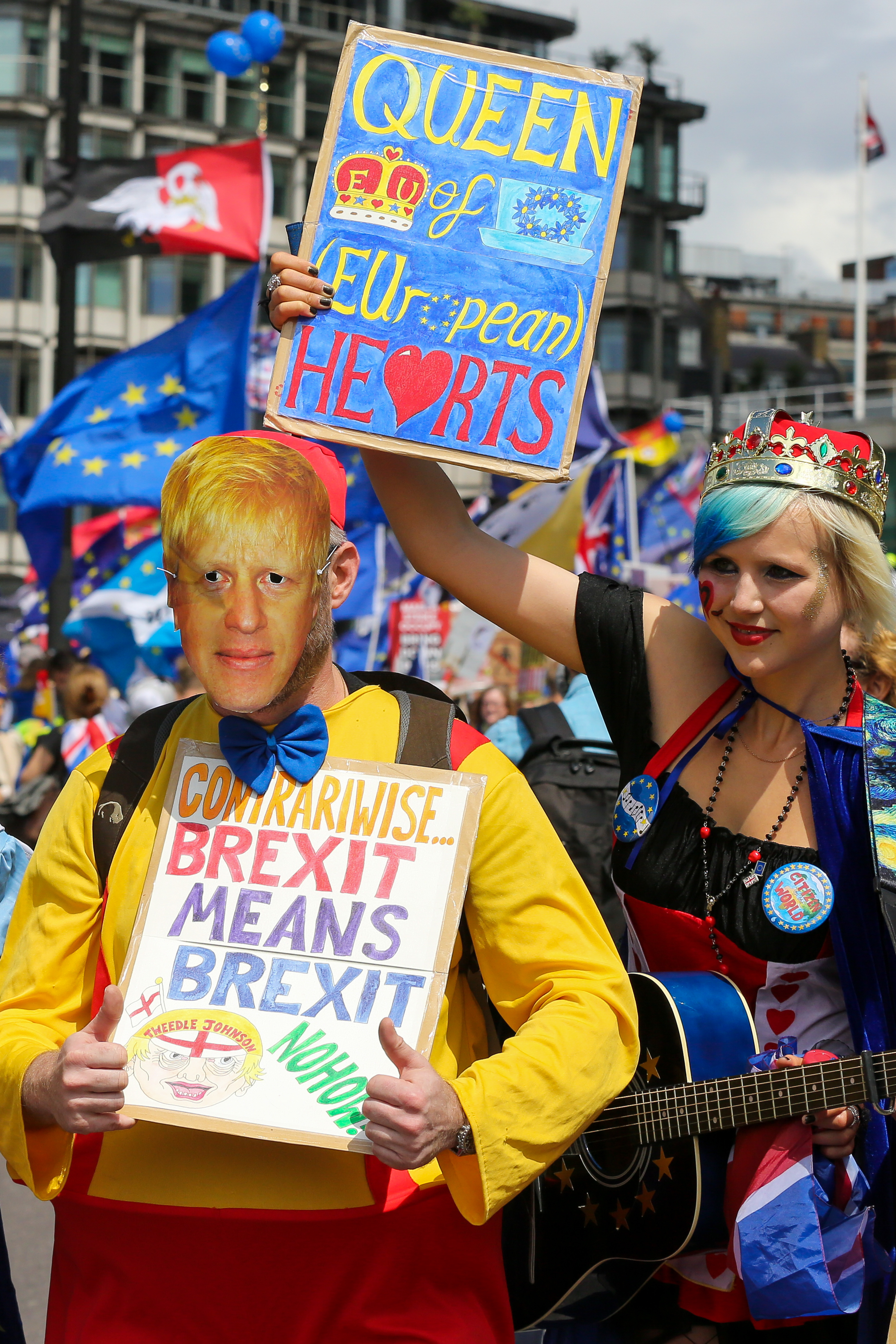 A Pro EU demonstrator is seen wearing Conservative Party leadership contender Boris Johnson's face mask while holding a placard, during the �No to Boris. Yes to Europe� march in central London. (Photo by Dinendra Haria / SOPA Images/Sipa USA)