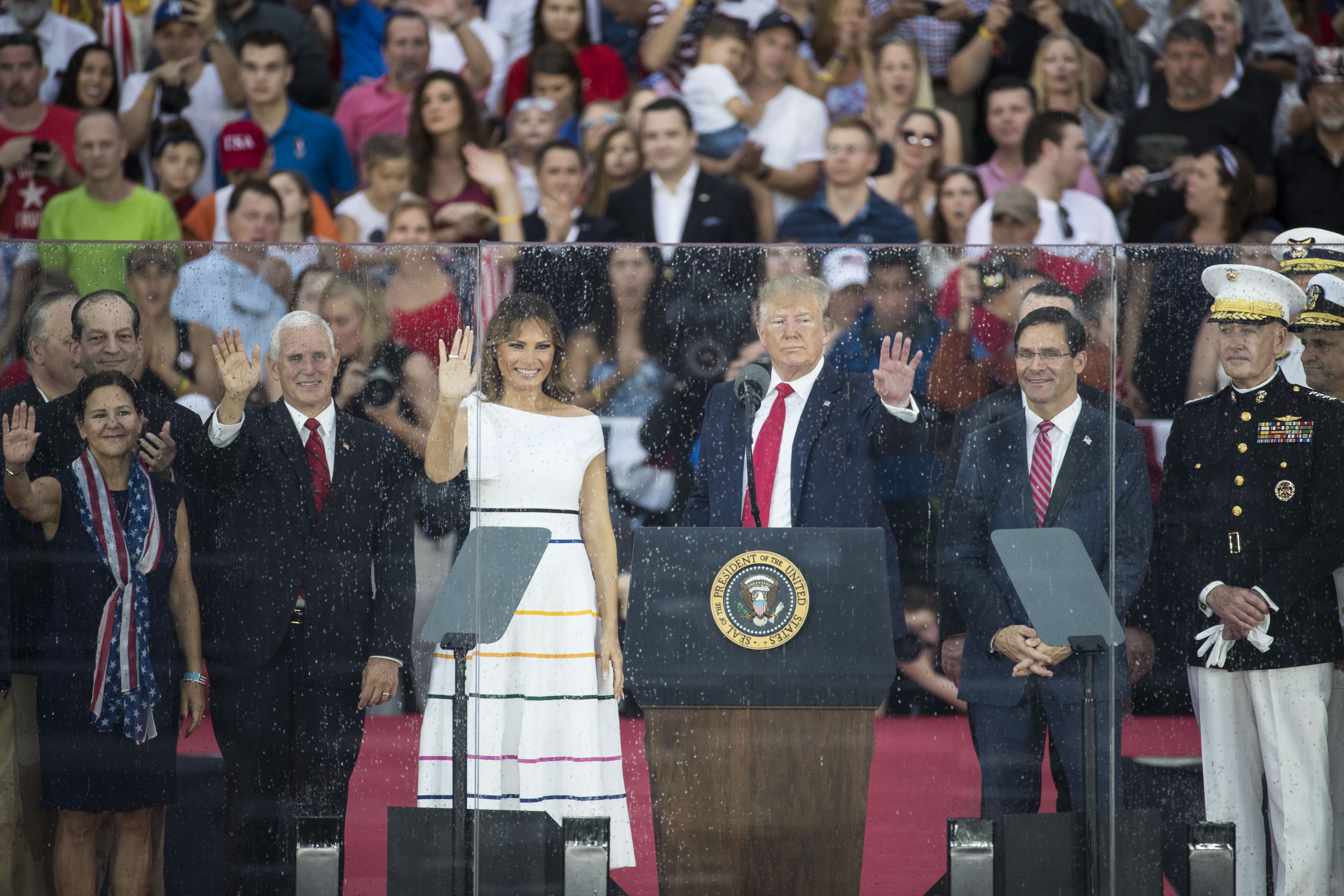 """WASHINGTON, DC - JULY 04: President Donald Trump, First Lady Melania Trump, Vice President Mike Pence and Second Lady Karen Pence stand on stage after President Donald Trump spoke at the """"Salute to America"""" ceremony in front of the Lincoln Memorial, on July 4, 2019 in Washington, DC. The presentation featured armored vehicles on display, a flyover by Air Force One, and several flyovers by other military aircraft. (Photo by Sarah Silbiger/Getty Images)"""