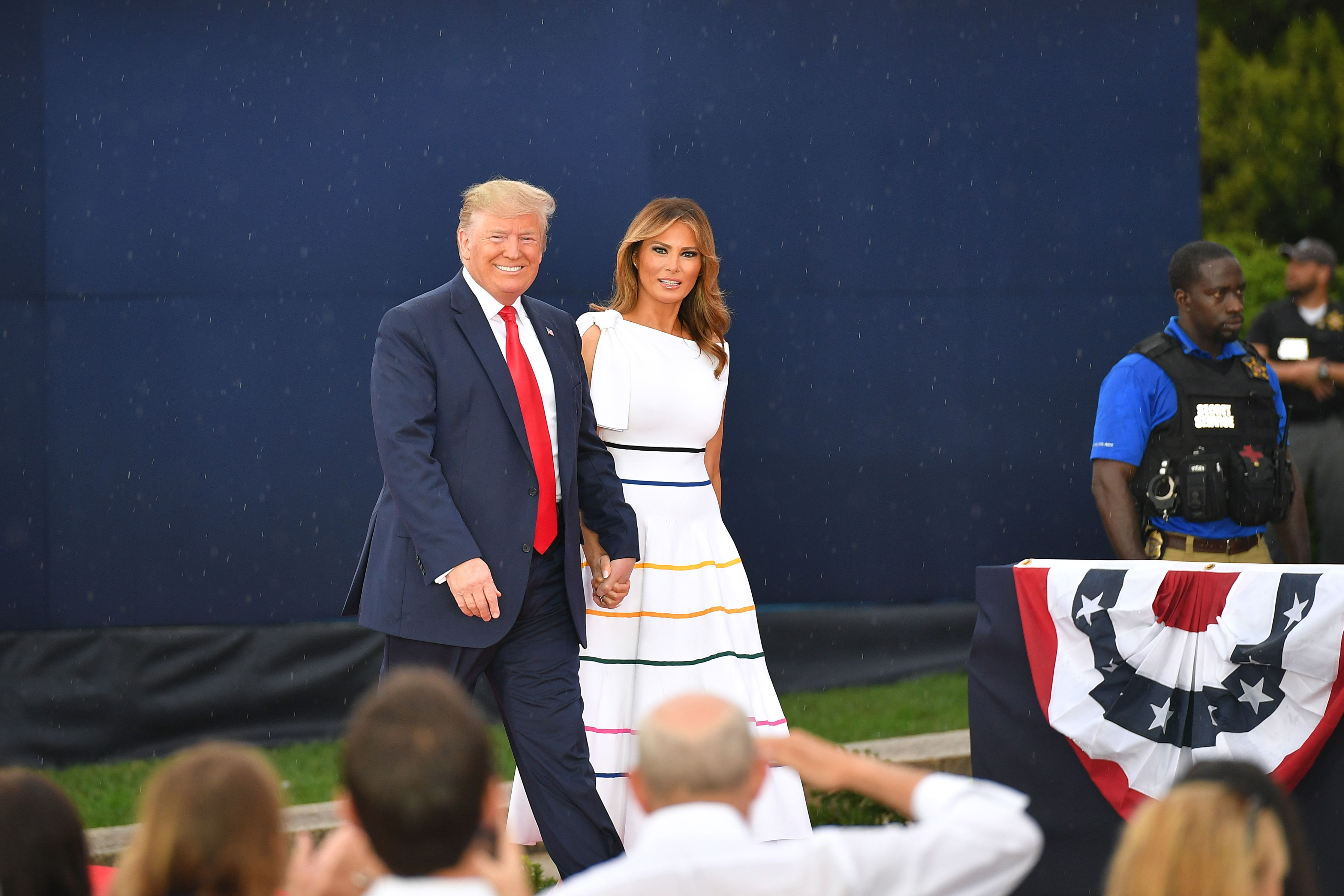 """US President Donald Trump (L) and US First Lady Melania Trump arrive for the """"Salute to America"""" Fourth of July event at the Lincoln Memorial in Washington, DC, July 4, 2019. (Photo by MANDEL NGAN / AFP)        (Photo credit should read MANDEL NGAN/AFP/Getty Images)"""