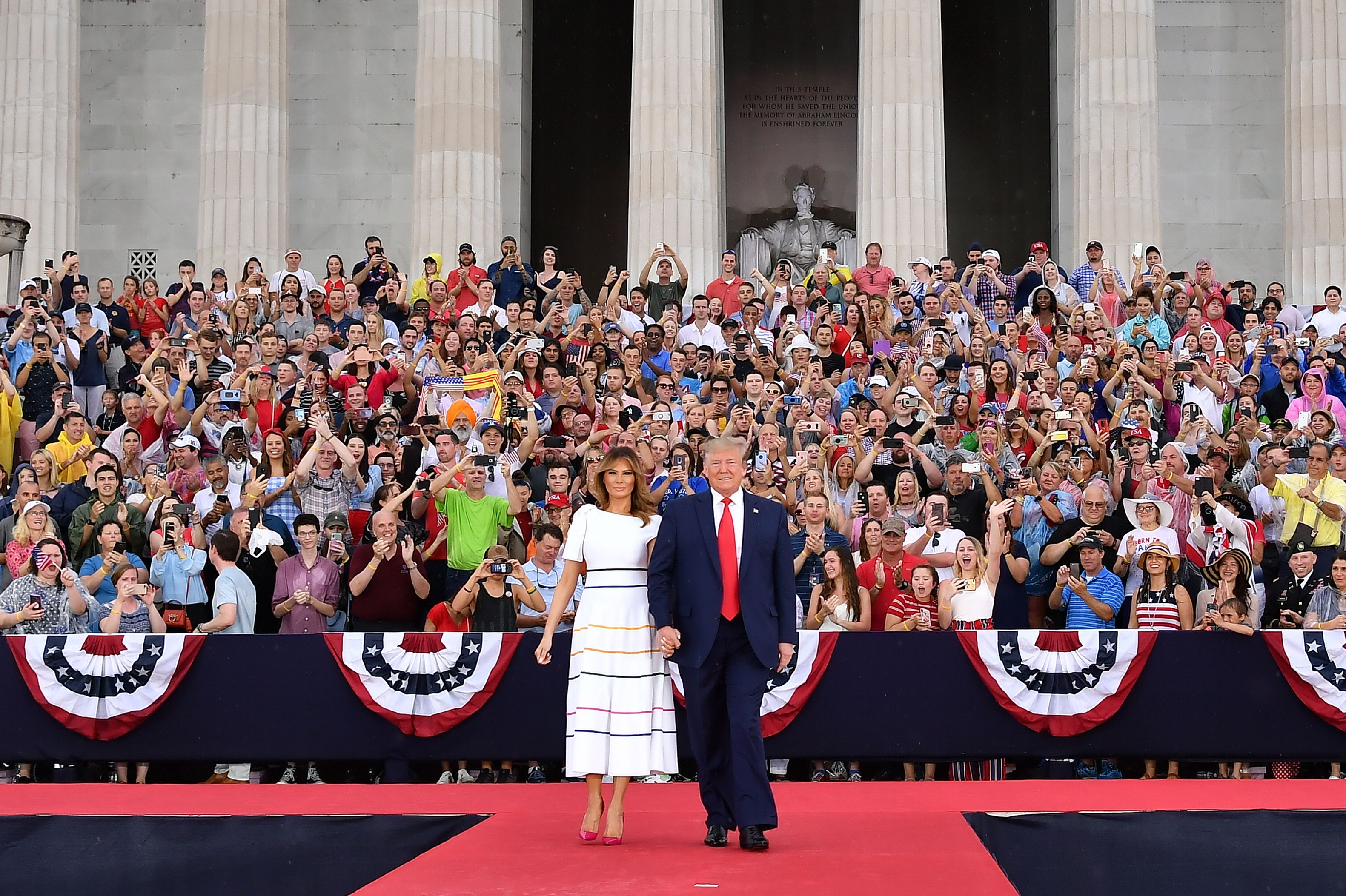 """US President Donald Trump and First Lady Melania Trump arrive to the """"Salute to America"""" Fourth of July event at the Lincoln Memorial in Washington, DC, July 4, 2019. (Photo by MANDEL NGAN / AFP)        (Photo credit should read MANDEL NGAN/AFP/Getty Images)"""