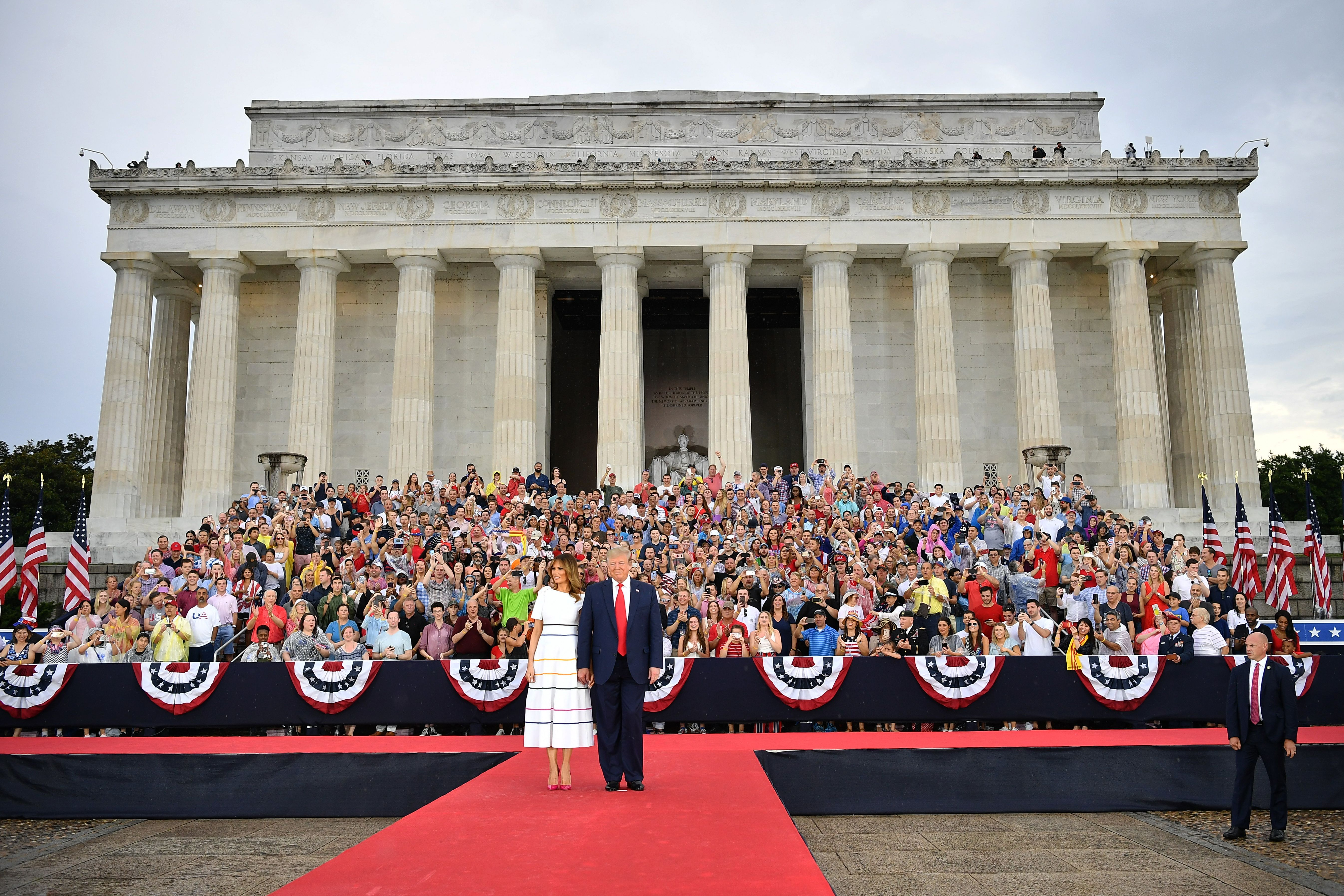 """US President Donald Trump and First Lady Melania Trump arrive to """"Salute to America"""" Fourth of July event at the Lincoln Memorial in Washington, DC, July 4, 2019. (Photo by MANDEL NGAN / AFP)        (Photo credit should read MANDEL NGAN/AFP/Getty Images)"""