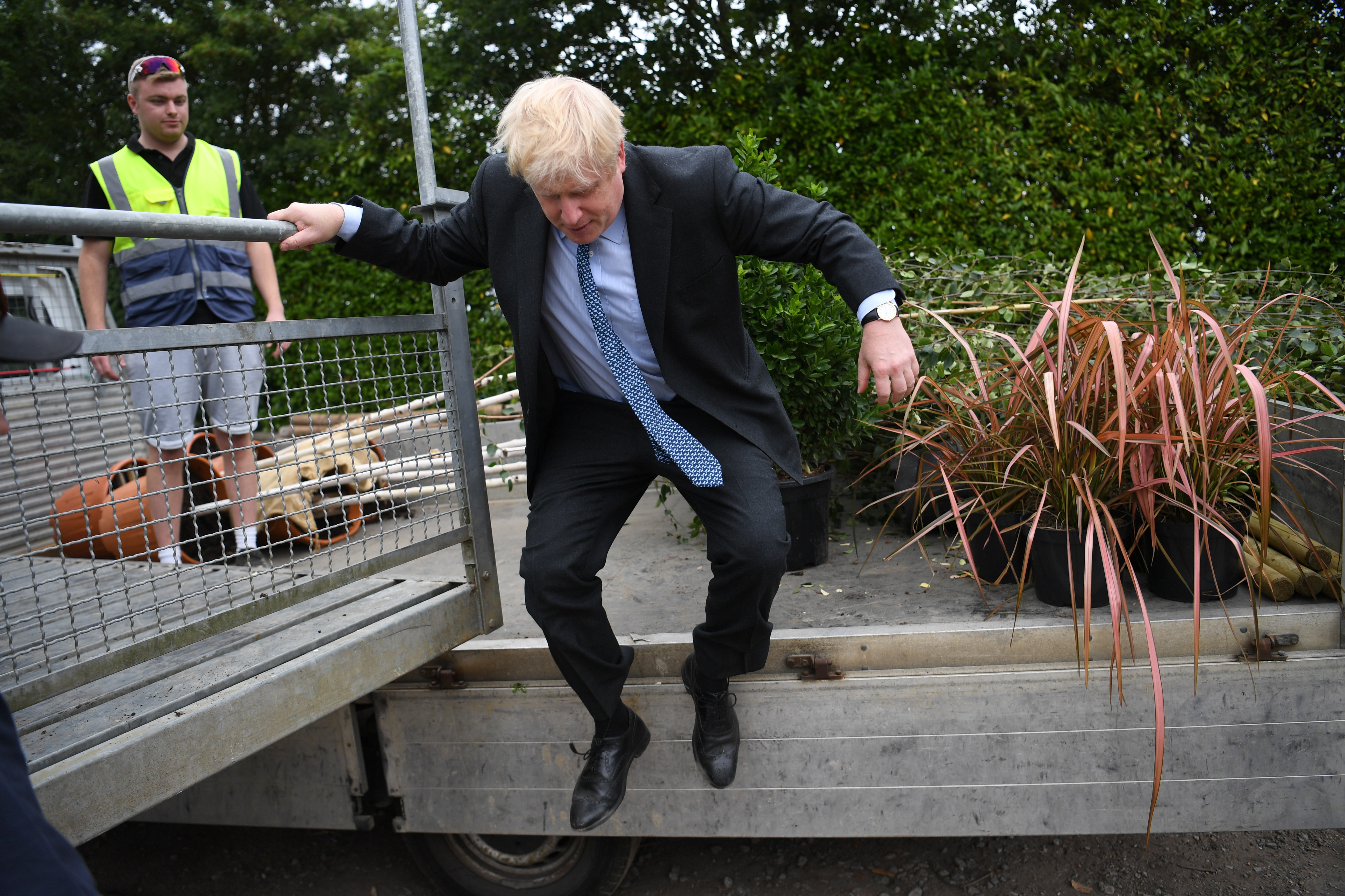 Conservative Party leadership candidate Boris Johnson jumps down from a trailer during a visit to King & Co tree nursery, in Braintree, Essex, ahead of the Tory leadership hustings in Colchester, Essex.