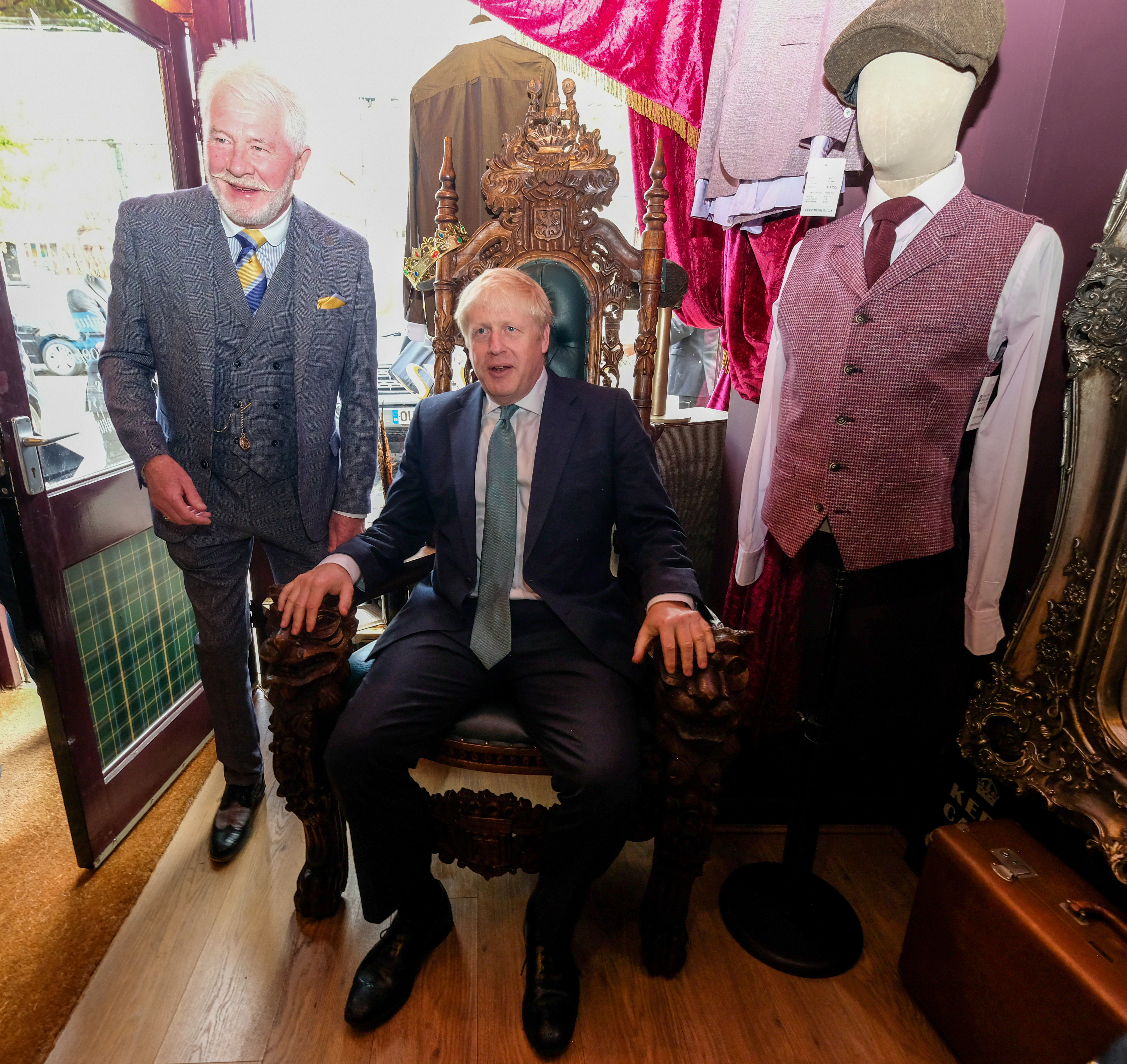 Conservative party leadership candidate Boris Johnson sits in a chair in a clothing shop during a visit to Guisborough, North Yorkshire.