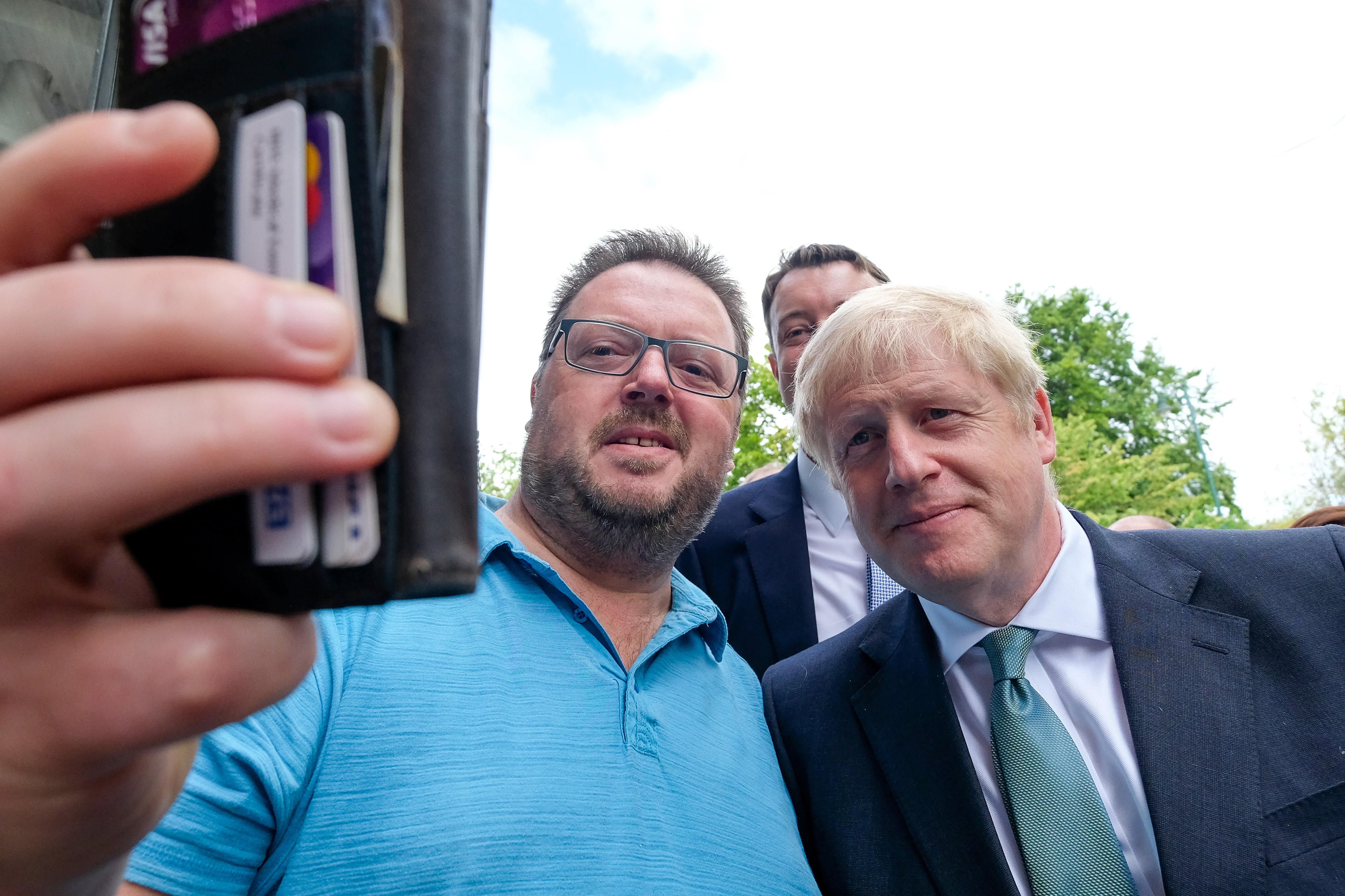 Conservative party leadership candidate Boris Johnson poses for a selfie with a steelworker during a visit to Guisborough, North Yorkshire.