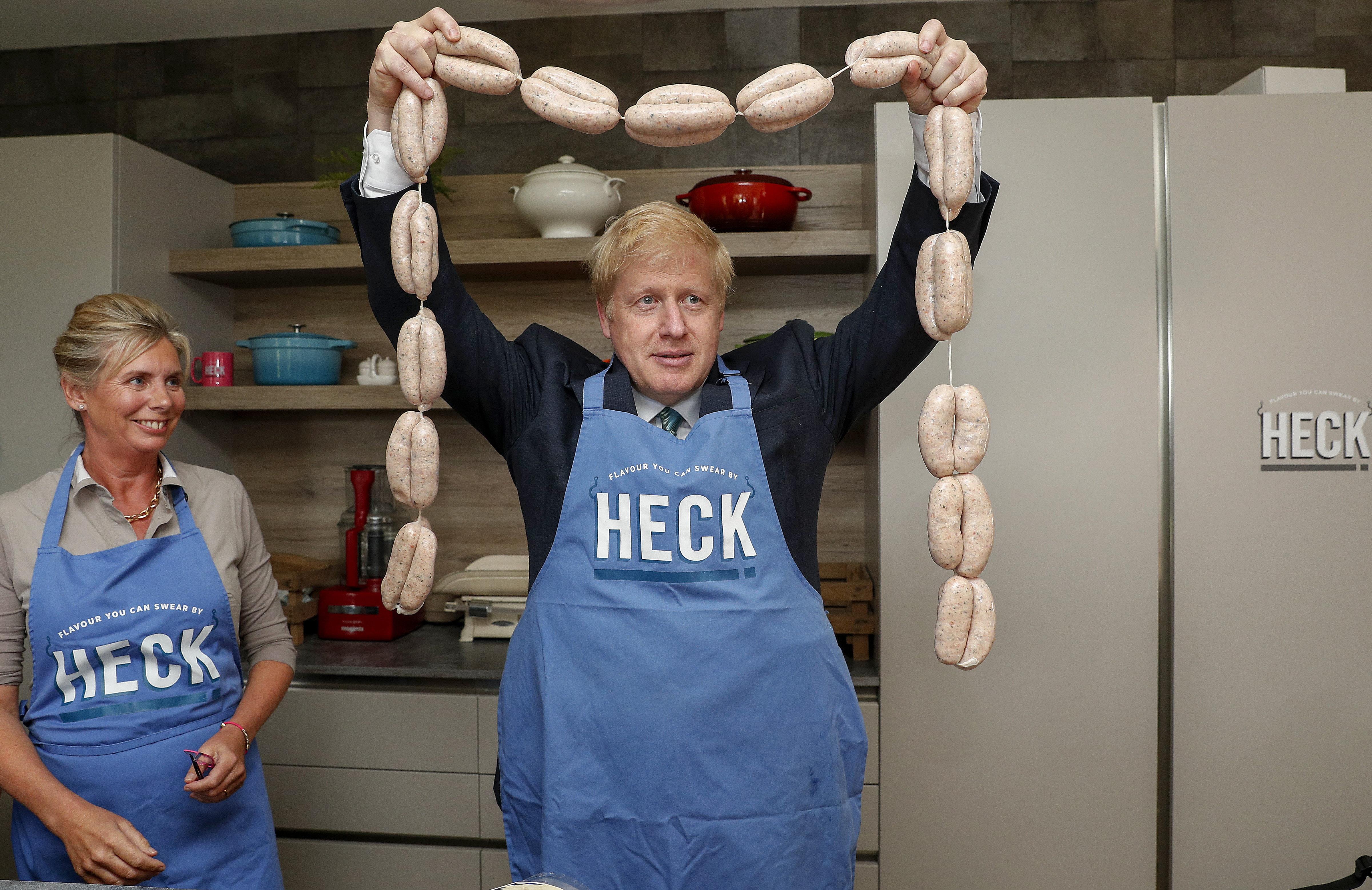 Conservative party leadership candidate Boris Johnson holds up a string of sausages around his neck during a visit to Heck Foods Ltd. headquarters near Bedale in North Yorkshire ahead of the latest hustings in York later.