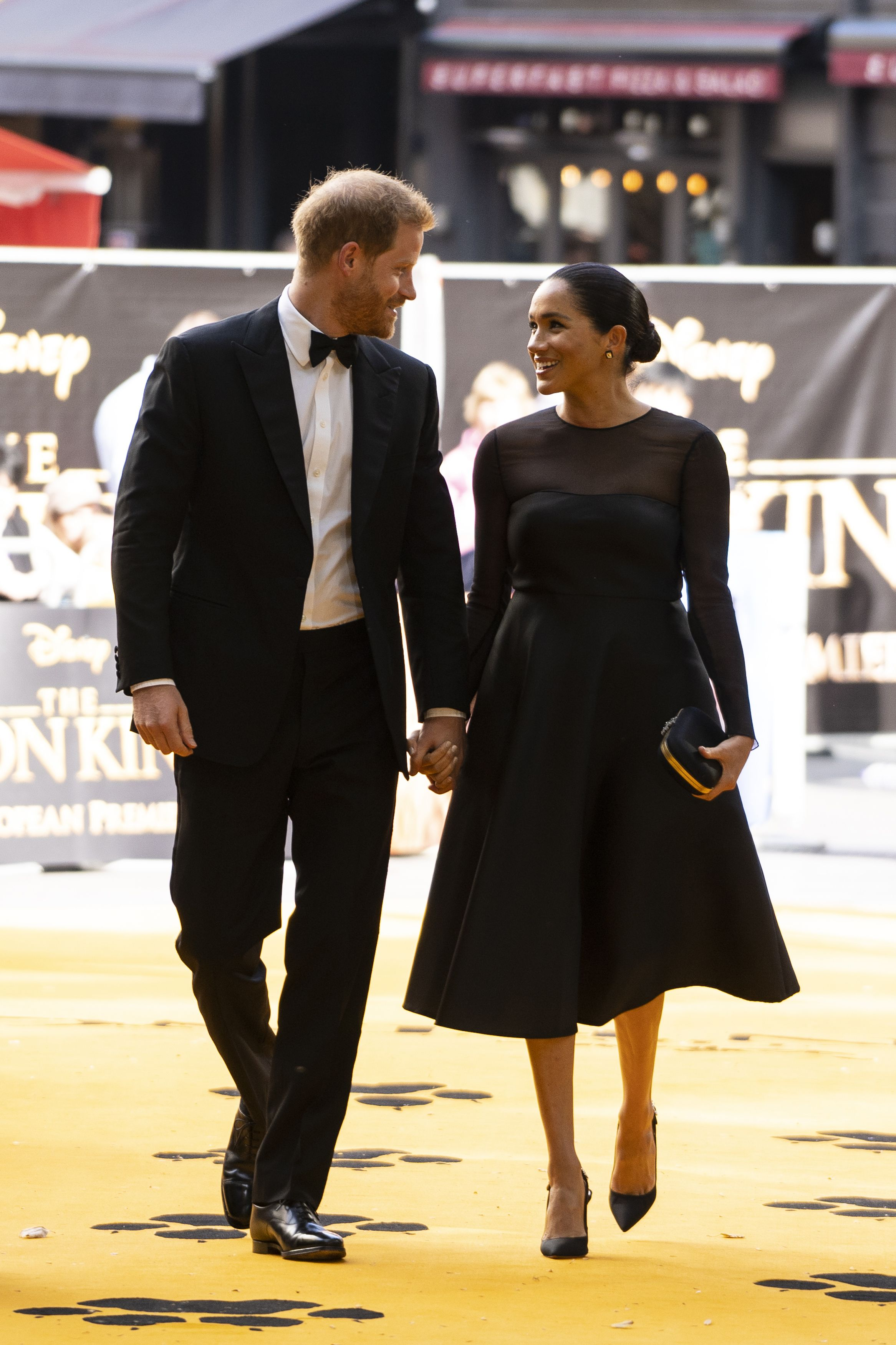 Britain's Prince Harry, Duke of Sussex (L) and Britain's Meghan, Duchess of Sussex (R) arrive to attend the European premiere of the film The Lion King in London on July 14, 2019. (Photo by Niklas HALLE'N / POOL / AFP)        (Photo credit should read NIKLAS HALLE'N/AFP/Getty Images)