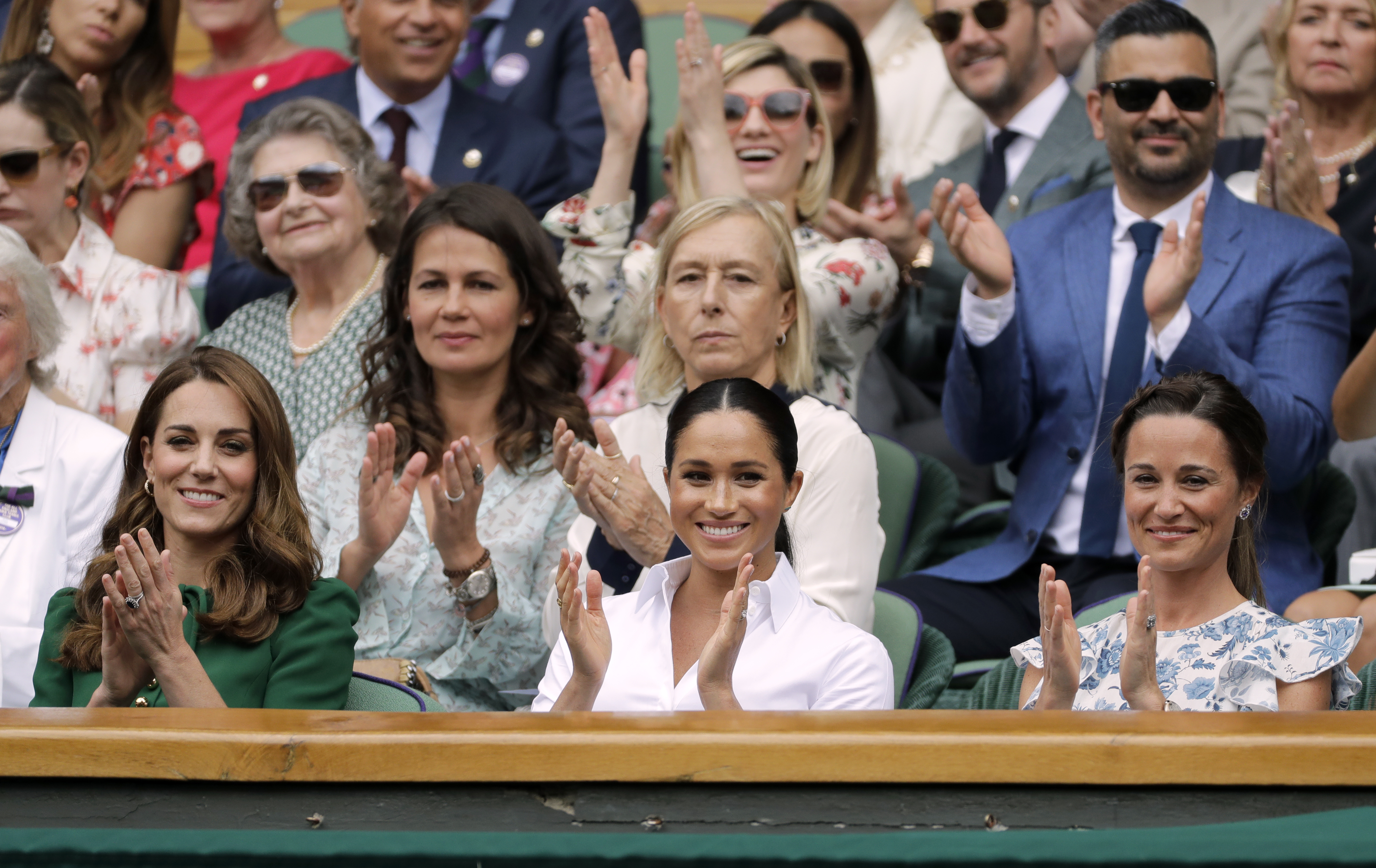 The Duchess of Cambridge and The Duchess of Sussex with Pippa Matthews during the women's singles final on day twelve of the Wimbledon Championships at the All England Lawn Tennis and Croquet Club, Wimbledon.