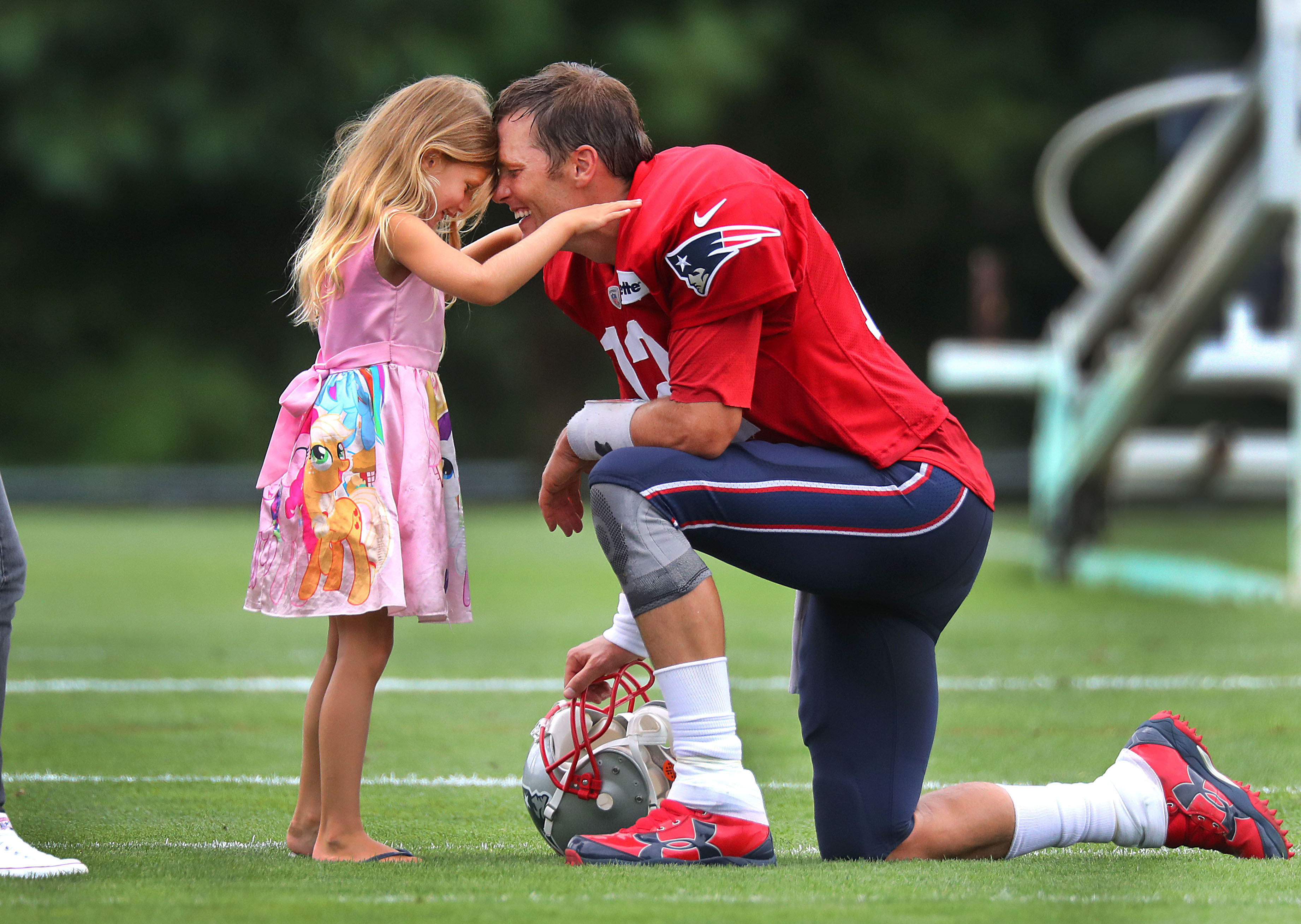 FOXBOROUGH, MA - AUGUST 1: New England Patriots quarterback Tom Brady spends some time with his daughter, Vivian, 5, after Patriots training camp at the Gillette Stadium practice facility in Foxborough, MA on Aug. 1, 2018. (Photo by John Tlumacki/The Boston Globe via Getty Images)