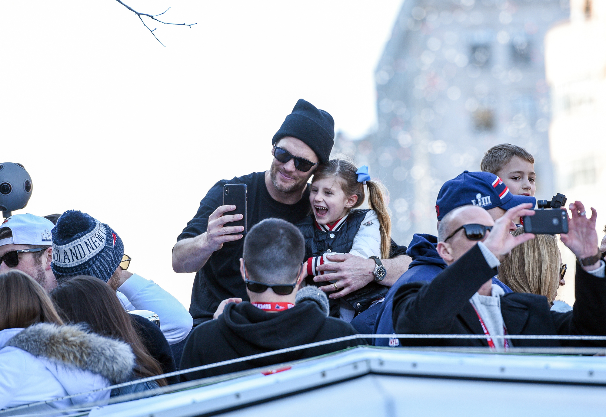 BOSTON, MA - FEBRUARY 5: Tom Brady and his daughter Vivian celebrate with thousands of fans who lined the streets of Boston to celebrate with the New England Patriots during their victory parade. February 5, 2019   (Photo By Faith Ninivaggi/ Boston Herald/ MediaNews Group via Getty Images)