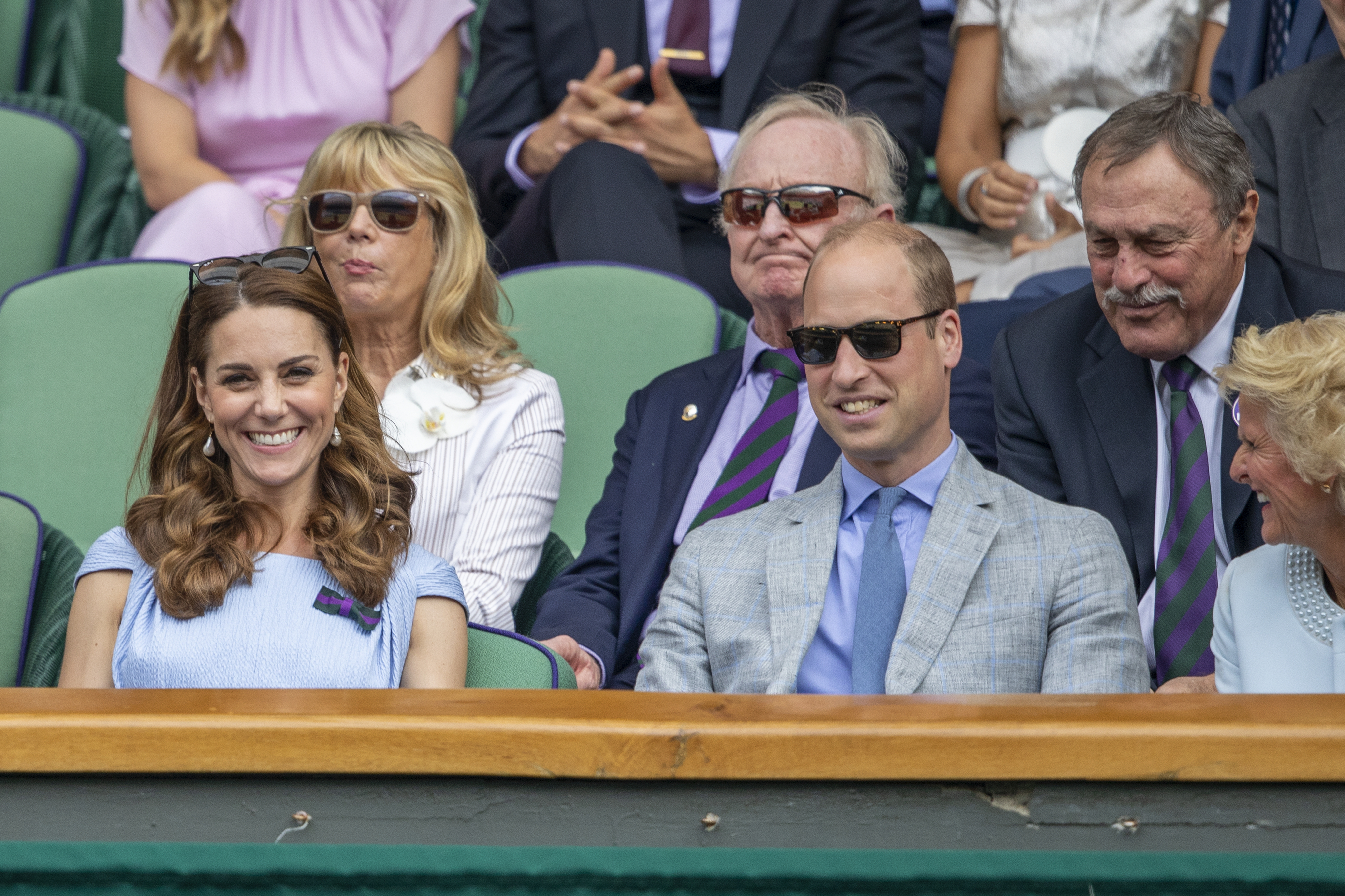 LONDON, ENGLAND - July 14:  Australian tennis legends John Newcombe and Rod Laver with Catherine, Duchess of Cambridge and Prince William, Duke of Cambridge in the Royal Box on Centre court during Men's Finals Day during the Wimbledon Lawn Tennis Championships at the All England Lawn Tennis and Croquet Club at Wimbledon on July 14, 2019 in London, England. (Photo by Tim Clayton/Corbis via Getty Images)