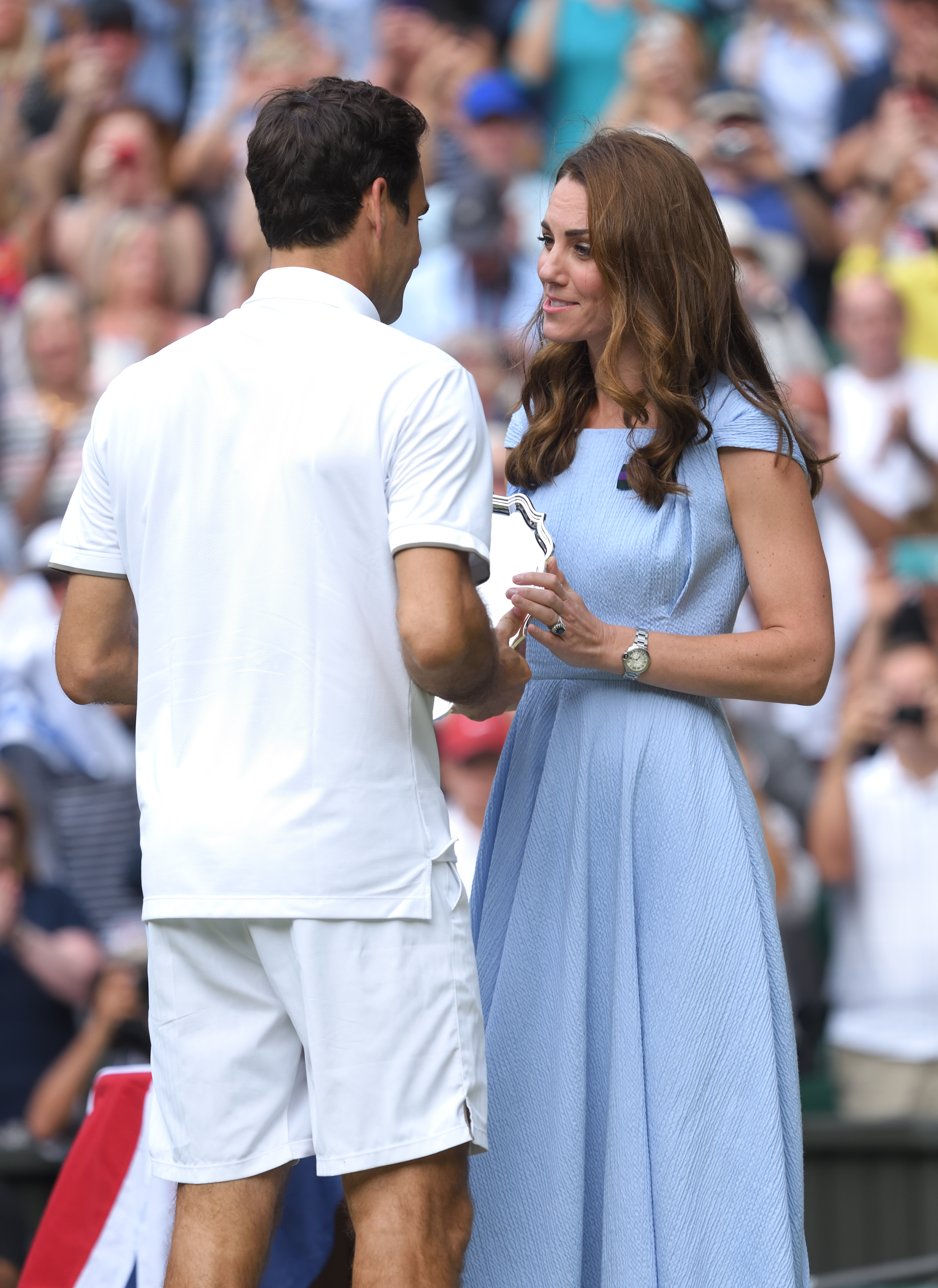 LONDON, ENGLAND - JULY 14: Roger Federer of Switzerland is presented with the runners-up trophy by Catherine, Duchess of Cambridge after his Men's Singles final against Novak Djokovic of Serbia during Day thirteen of the Wimbledon Tennis Championships at All England Lawn Tennis and Croquet Club on July 14, 2019 in London, England. (Photo by Karwai Tang/Getty Images)