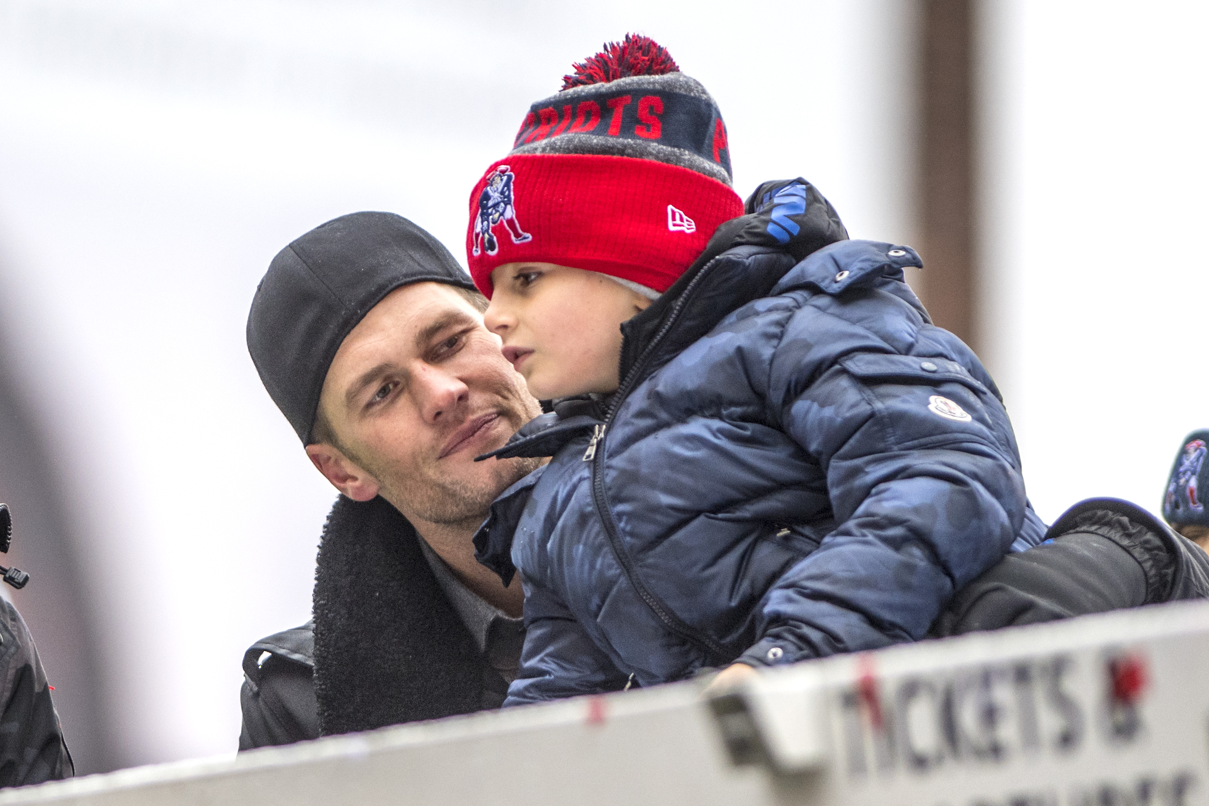 BOSTON, MA - FEBRUARY 07: Tom Brady of the New England Patriots celebrates with his son Benjamin during the Super Bowl victory parade on February 7, 2017 in Boston, Massachusetts. The Patriots defeated the Atlanta Falcons 34-28 in overtime in Super Bowl 51. (Photo by Billie Weiss/Getty Images)