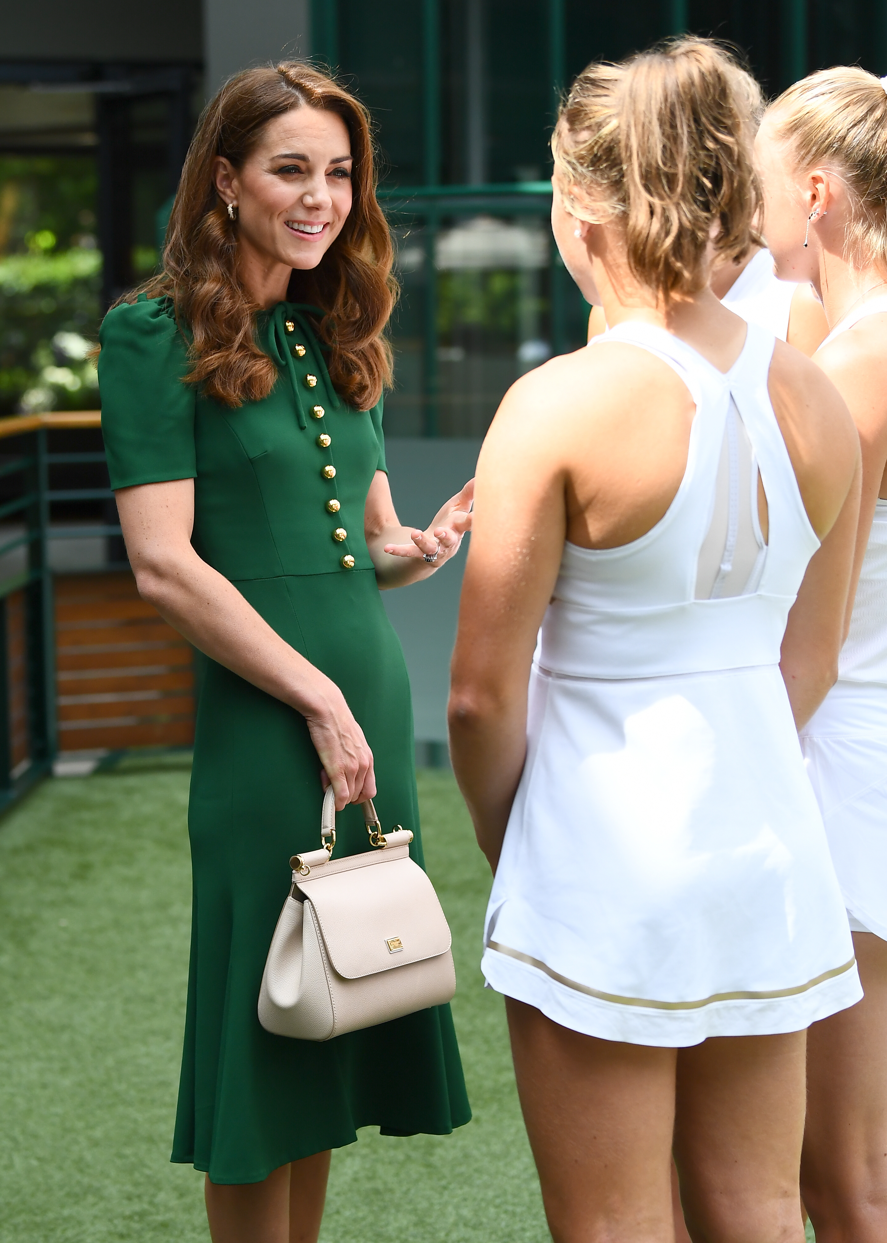 The Duchess of Cambridge meets junior players ahead of the Women's Final on day twelve of the Wimbledon Championships at the All England Lawn Tennis and Croquet Club, Wimbledon.