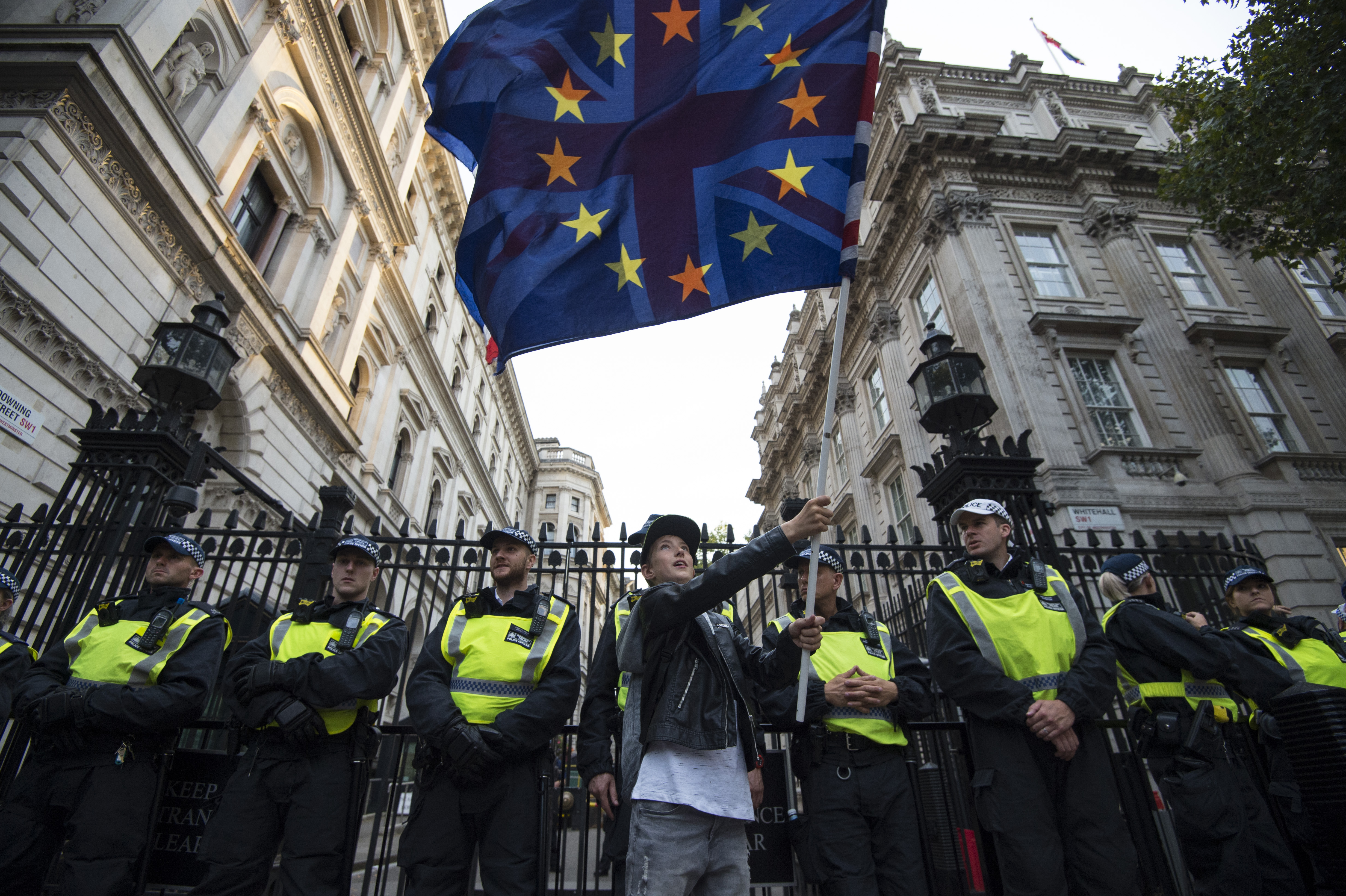 Kayden, 11, waves an EU flag and Union Jack in front of a line of police officers outside Downing Street, London, to demonstrate against Prime Minister Boris Johnson temporarily closing down the Commons from the second week of September until October 14 when there will be a Queen's Speech to open a new session of Parliament.