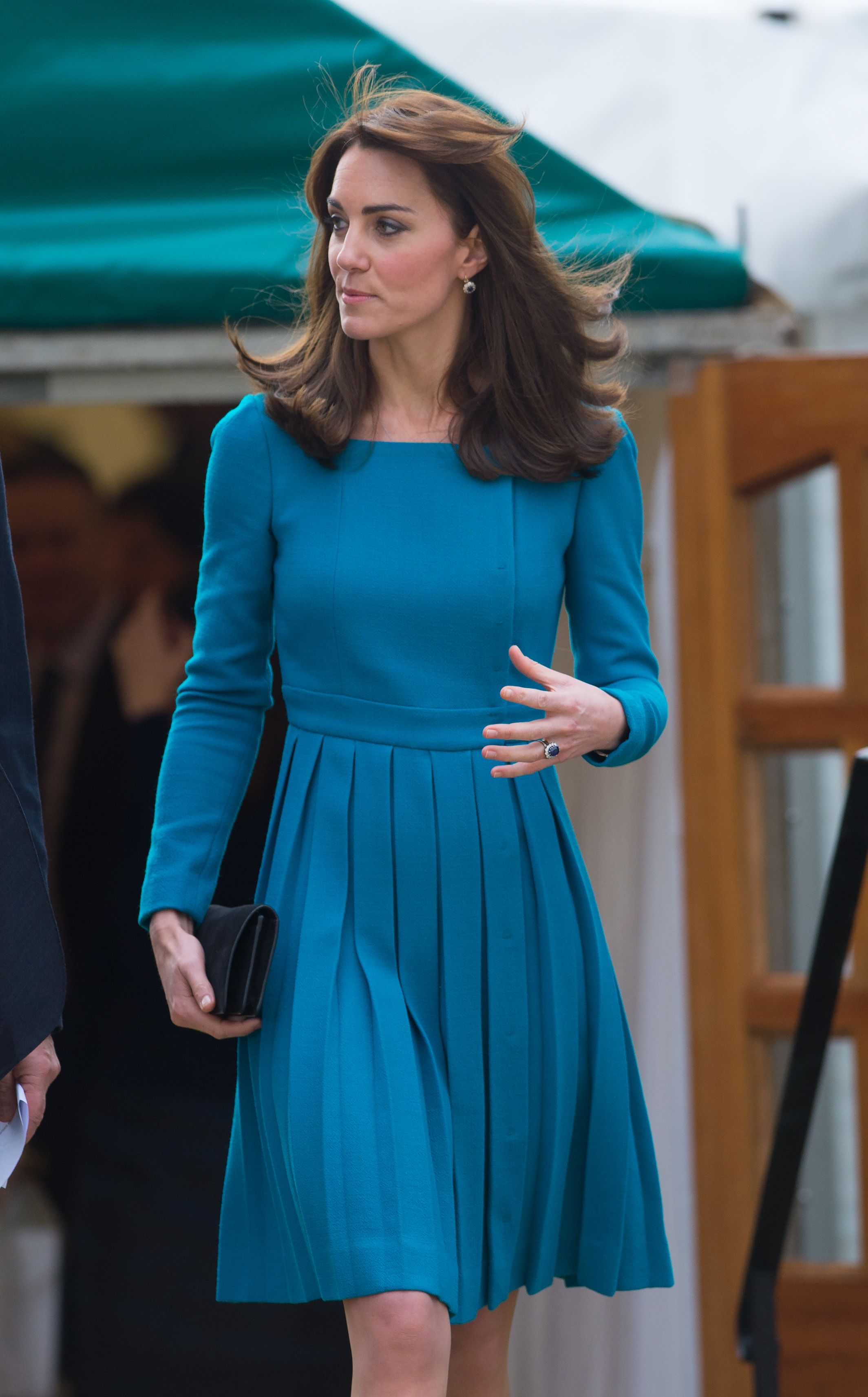 Catherine, Duchess of Cambridge, wearing a blue Emilia Wickstead dress and a Reiss coat, visits Action on Addiction in Warminster, WIltshire (Photo by Zak Hussein/Corbis via Getty Images)