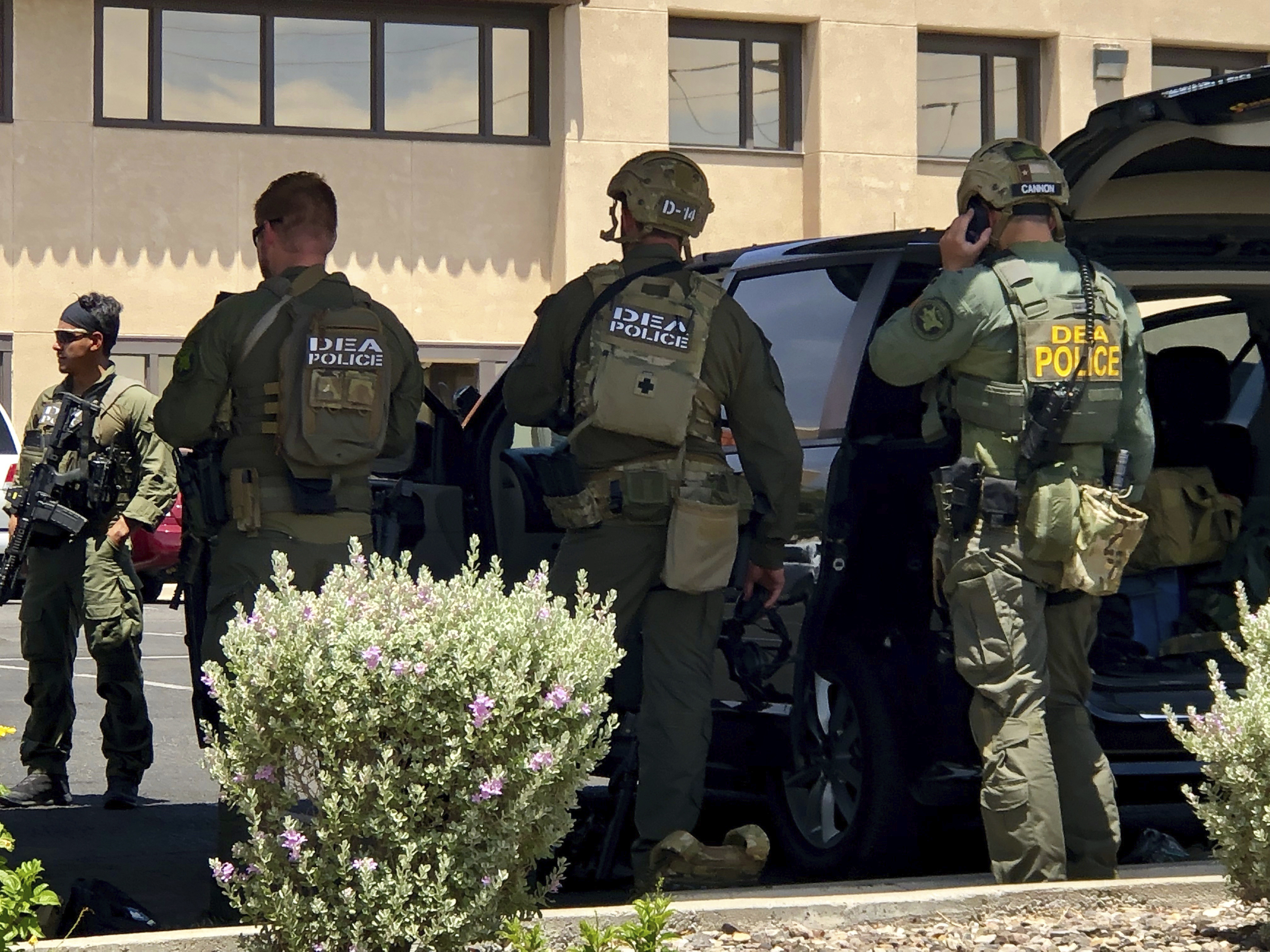Law enforcement from different agencies work the scene of a shooting  at a shopping mall in El Paso, Texas, on Saturday, Aug. 3, 2019.   Multiple people were killed and one person was in custody after a shooter went on a rampage at a shopping mall, police in the Texas border town of El Paso said. (AP Photo/Rudy Gutierrez)