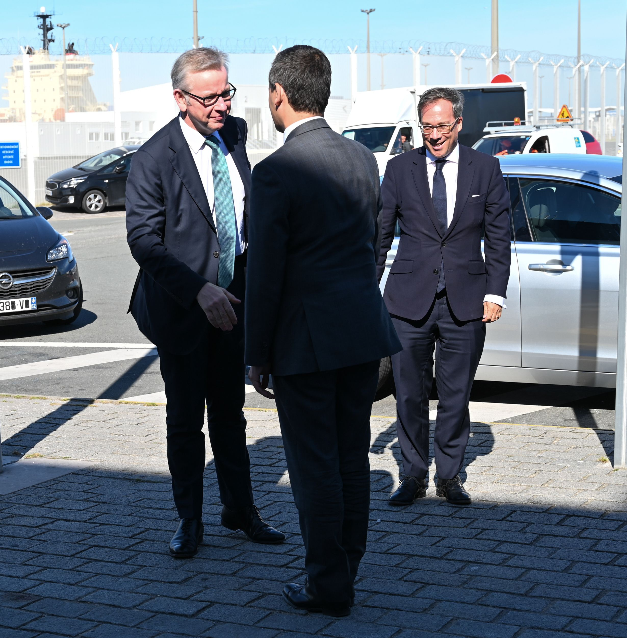 French Minister of Public Action and Accounts Gerald Darmanin (C) shakes hands with Britain's Chancellor of the Duchy of Lancaster Michael Gove (L) in the northern French port of Calais on August 30, 2019. (Photo by DENIS CHARLET / AFP)        (Photo credit should read DENIS CHARLET/AFP/Getty Images)
