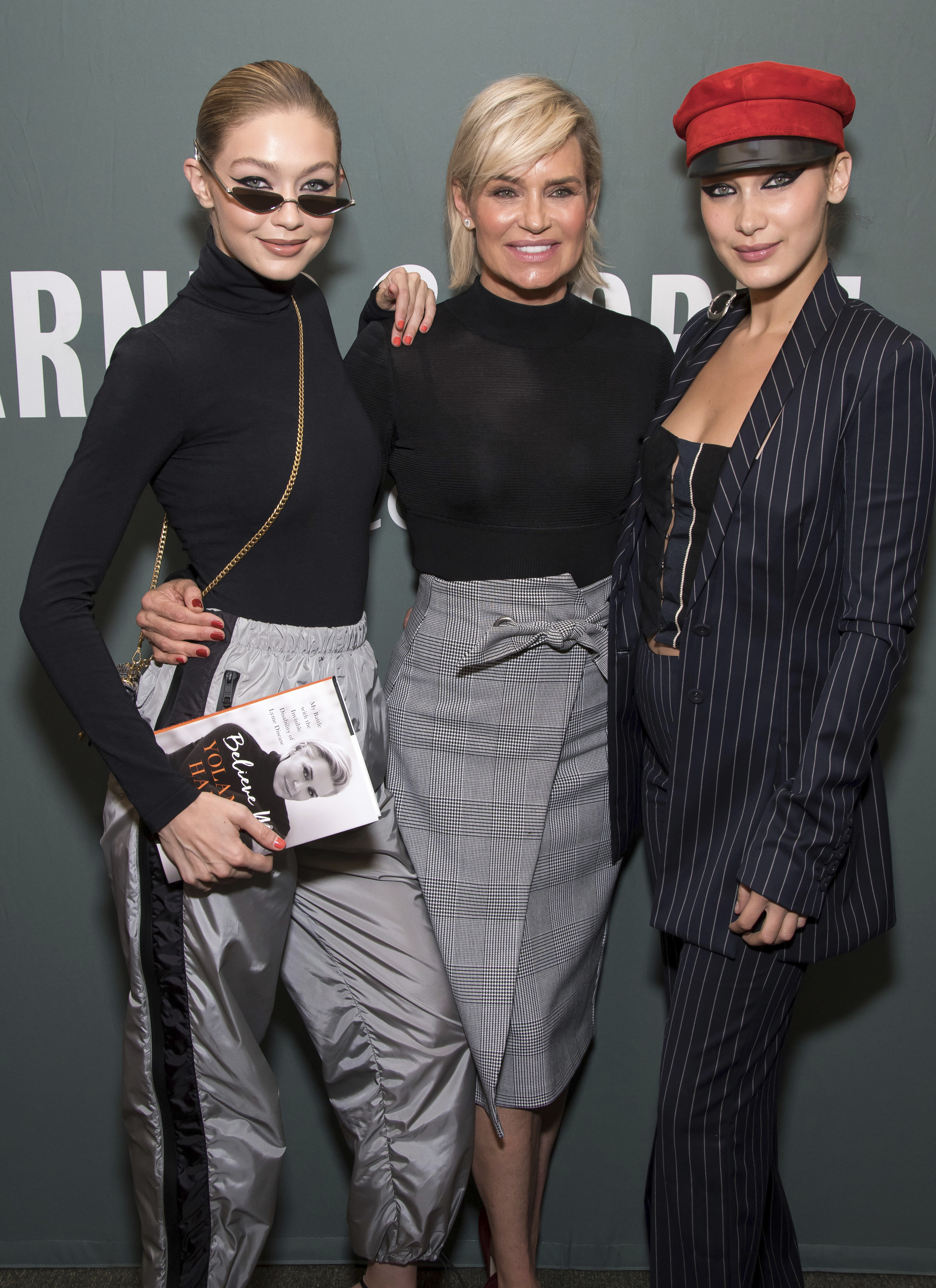 """Gigi Hadid, left, Yolanda Hadid and Bella Hadid attend a book signing for Yolanda's memoir """"Believe Me"""" at Barnes & Noble on Wednesday, Sept. 13, 2017, in New York. (Photo by Charles Sykes/Invision/AP)"""